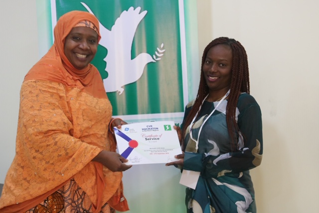 LR: Maryam Muhammad And Dr. Maryjane receiving certificate of honor
