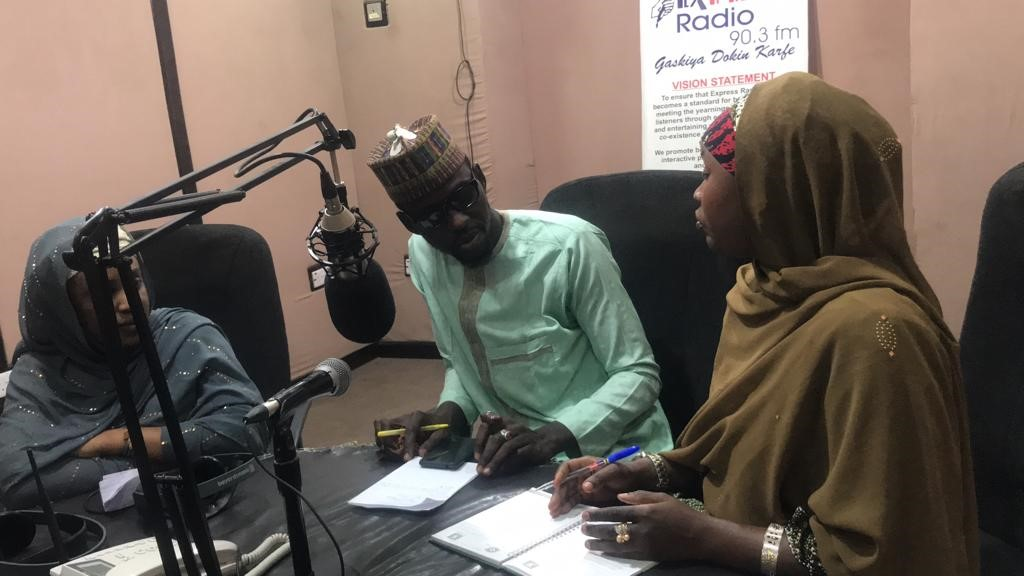 Khadija and Hadiza discussing on the Madubin Ilimi radio program on Express Radio.