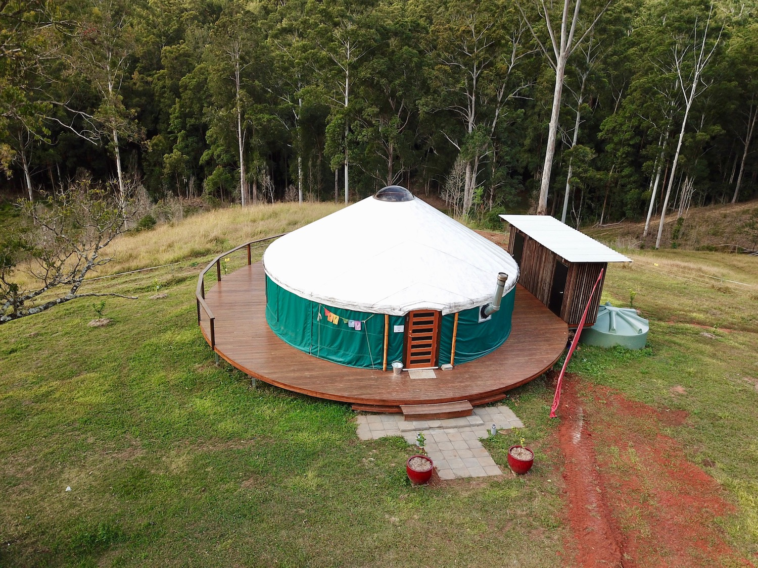 - An ancillary building alongside the yurt houses compost toilets for guests.