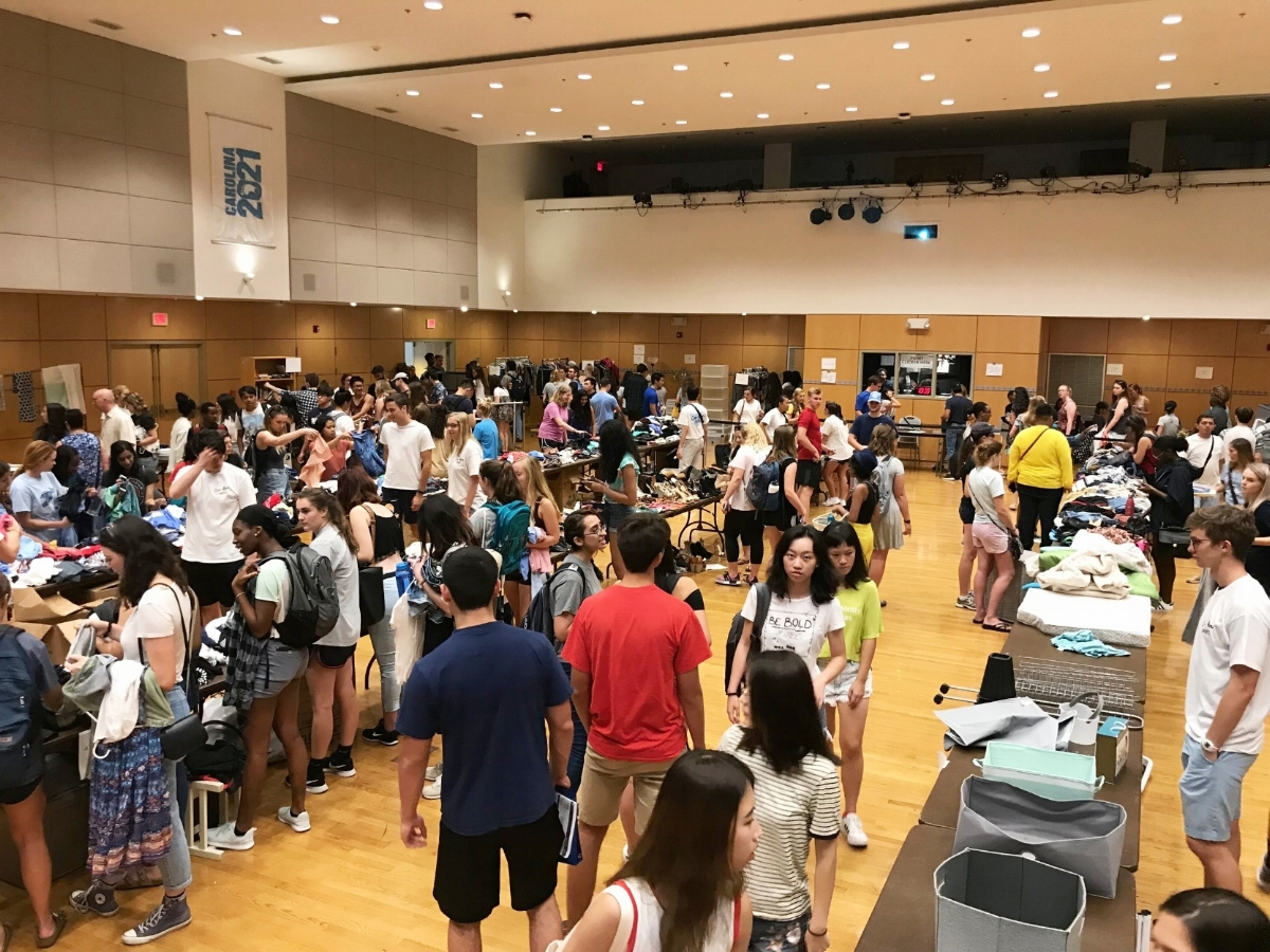 Students attending the inaugural sale in the Great Hall at the Student Union.