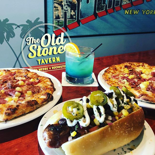"New Specials coming Friday! Come try our take on the most debated pizza of all time, our Hawaiian ""Aloha"" pizza topped with pineapple, bacon, and prosciutto.  Or try out our new dog special, the Mexican Tequila Stone Dog topped with a spicy black bean, corn salsa that's prepared with just a hint of silver tequila. Just a few of the specials @theoldstonetavern #oldstonetavernroc #OST #southwedge #southwedgerochester #southwedgerochesterny #bar #barlife #touchtunes #rochesterny #rocfood #alohapizza #summer #latenightfood l#latenightdrinks #pizza #tequilla #ellwangerbarry #pizzaislife #rocbartenders #Friday #theoldstonetavern"