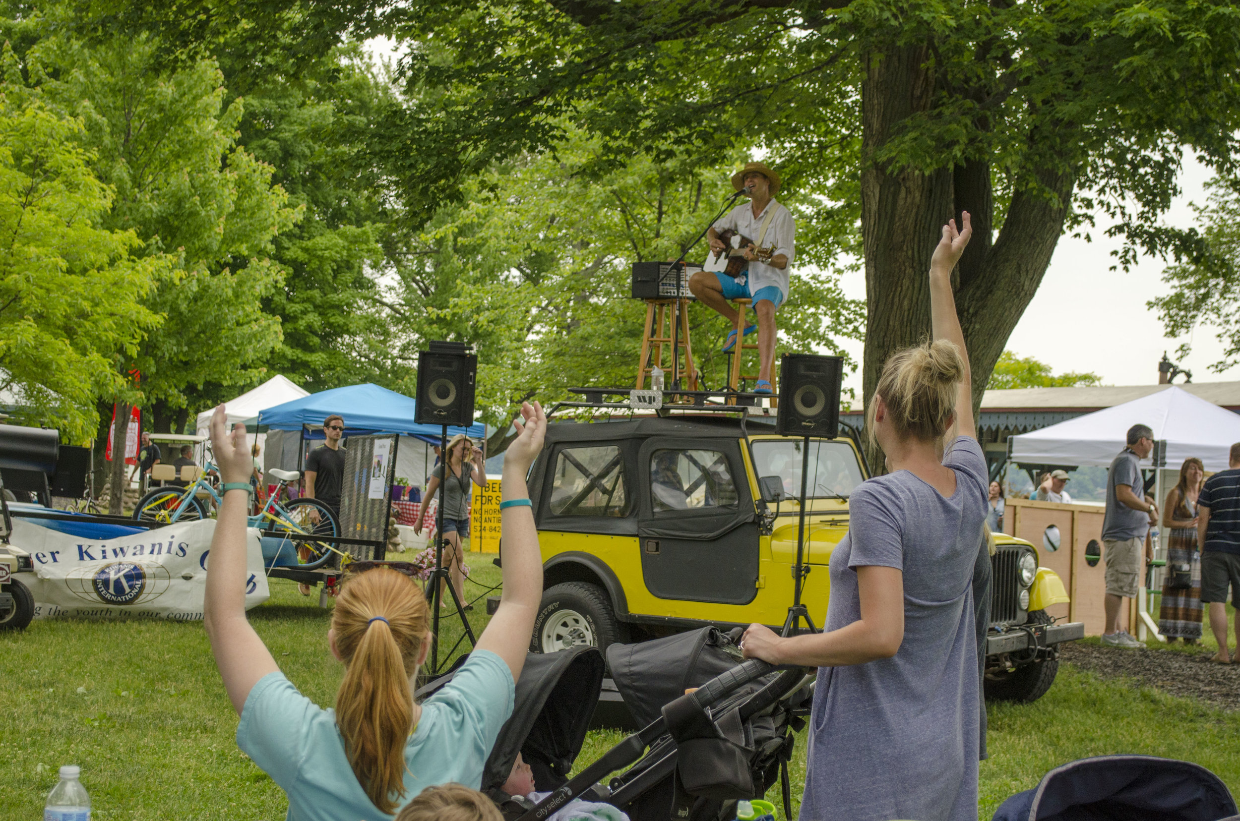 Chad Van Herk plays music from atop his Jeep.