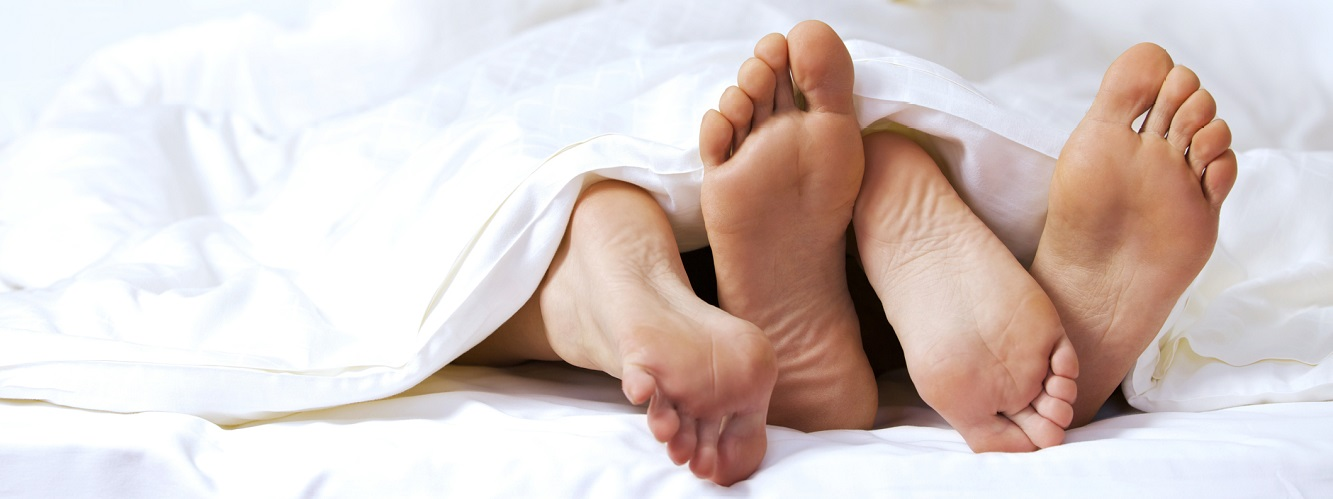 ThinkstockPhotos-468508740-close-up of feet in bed-cropped.jpg