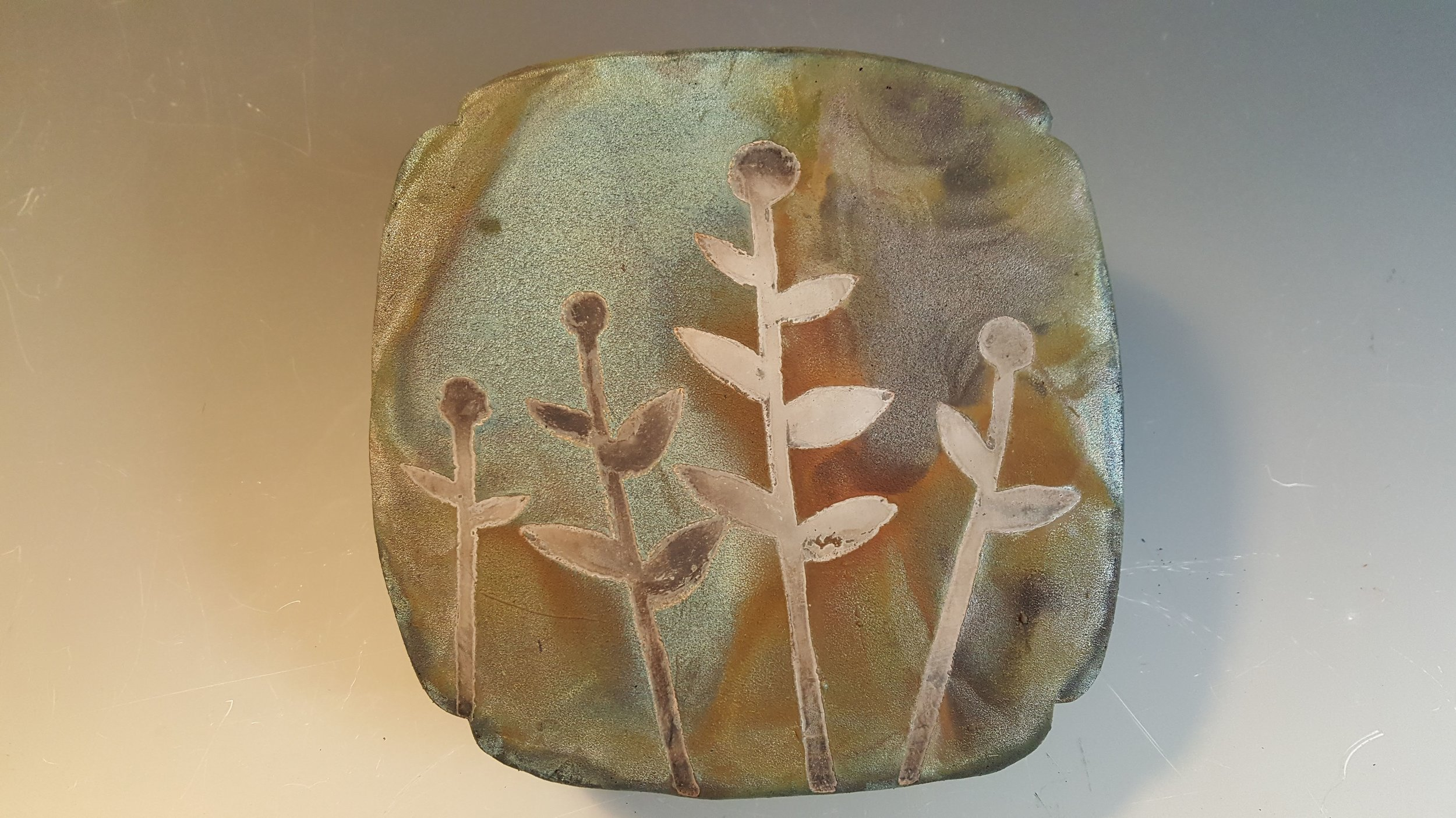 """Untitled"" 2018, raku-fired stoneware with paper resist design"
