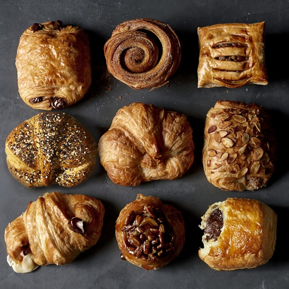 ASSORTED PASTRIES - CROISSANTS, COFFEE CAKE, APPLE DANISH, STICKY BUNS.