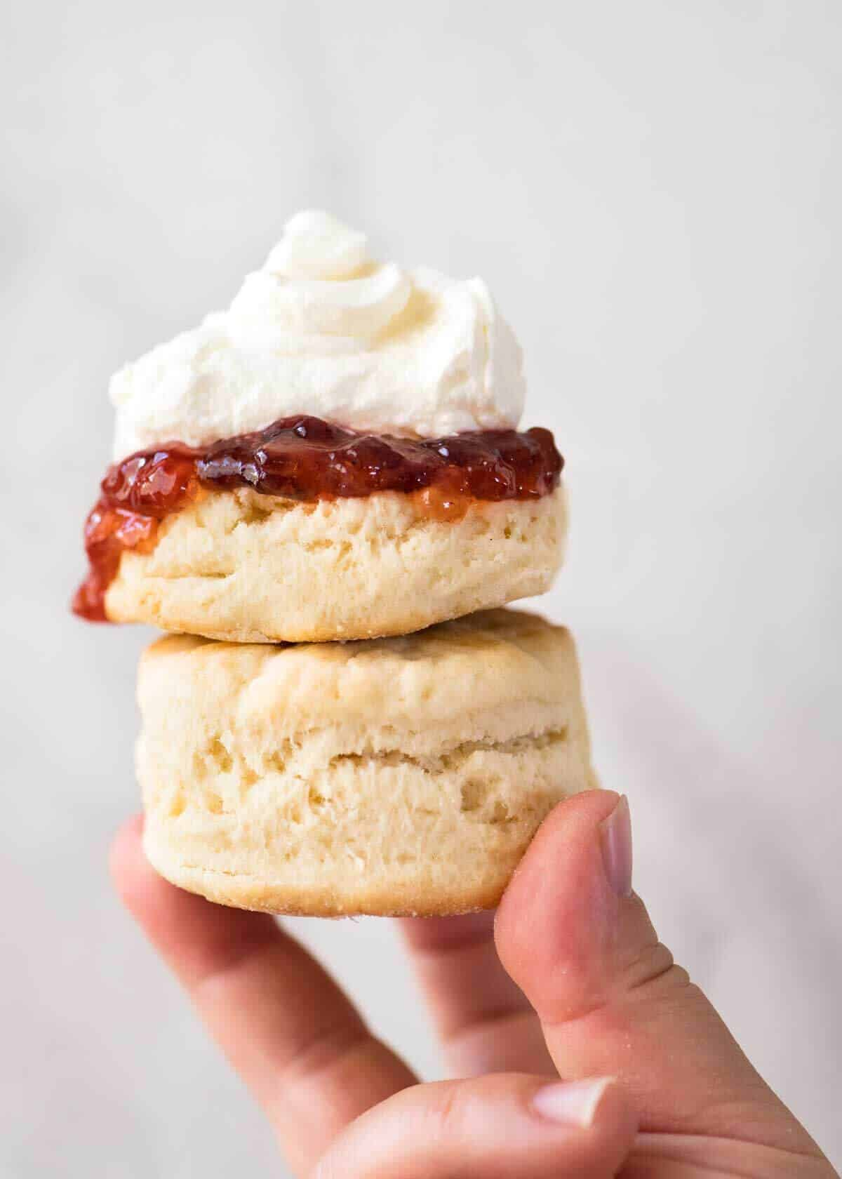 biscuits WITH JAM & CREAM - PLAIN BISCUIT, STRAWBERRY JAM, WHIPPED CREAM.