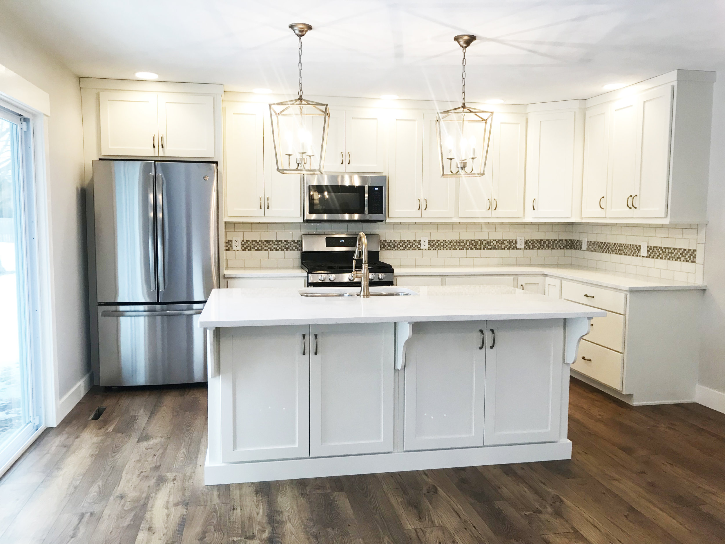 All new custom Amish-made cabinets and an oversized island make this kitchen family friendly!