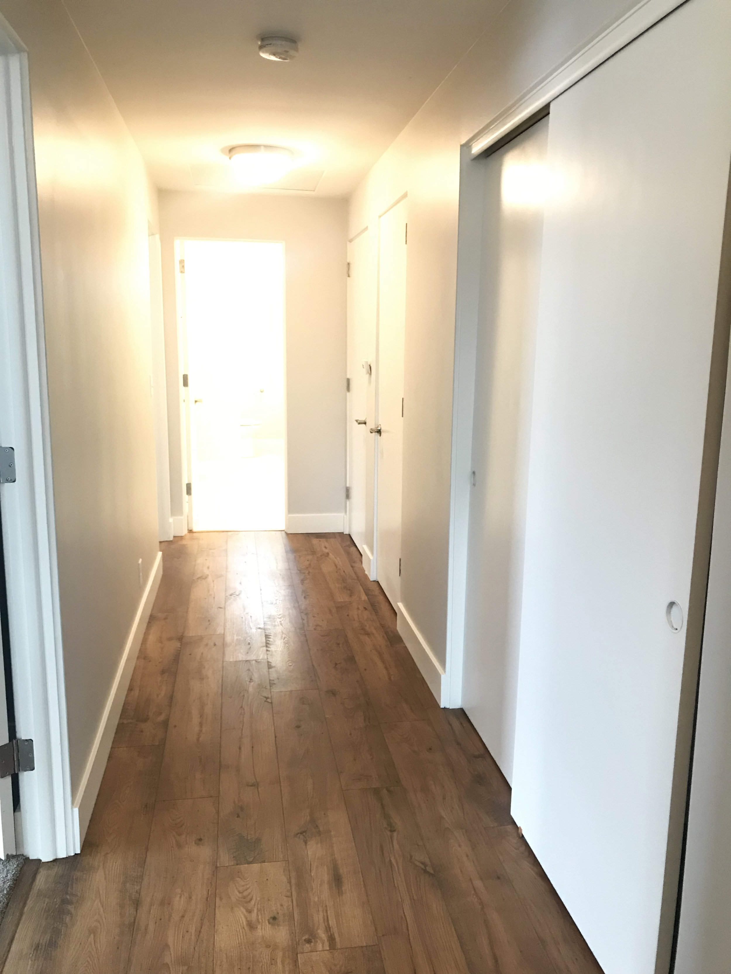 Spacious upstairs hallway with large closets.