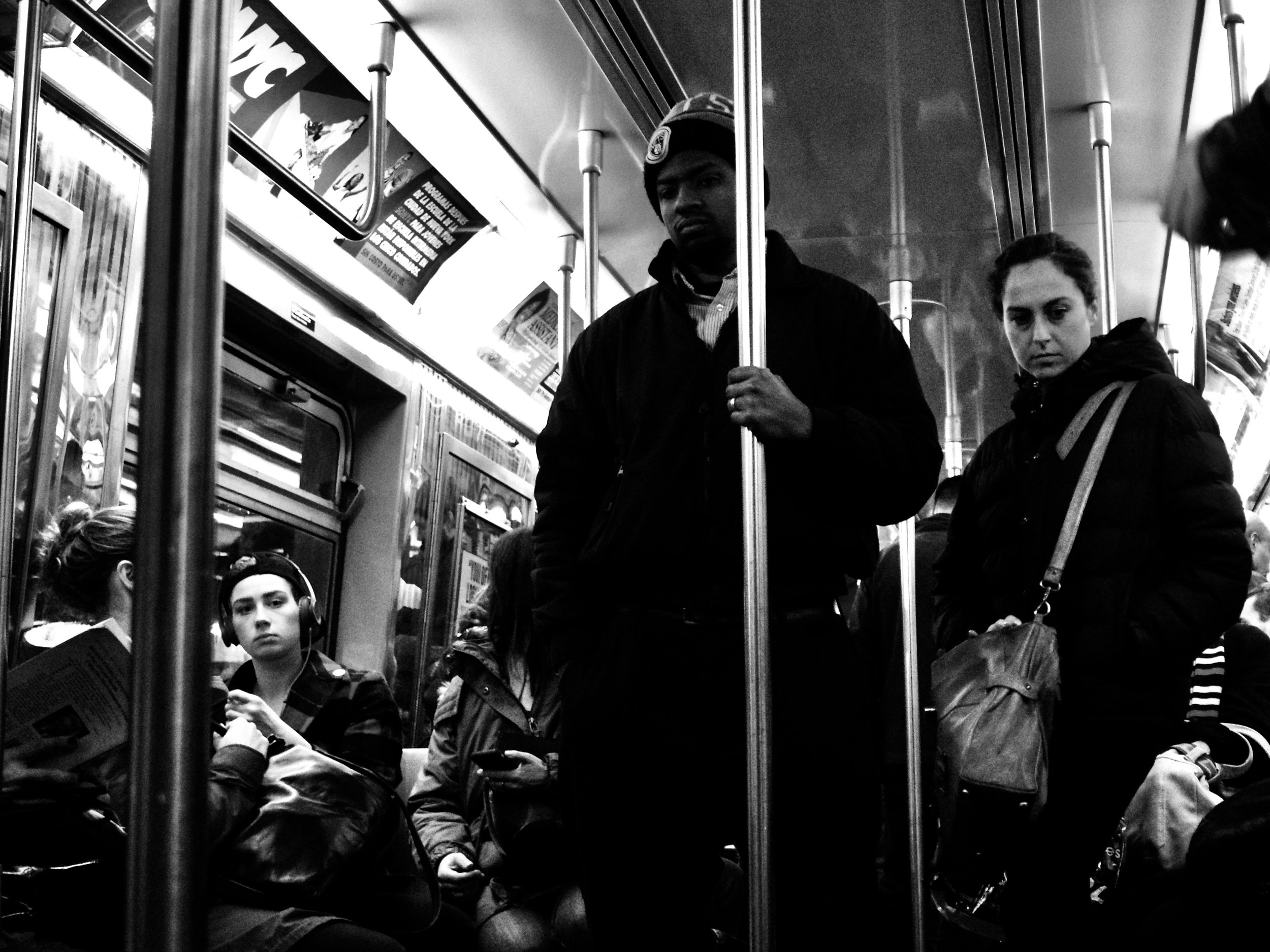 Commuters on a NYC train during rush hour.  Courtesy of Aldon Photos