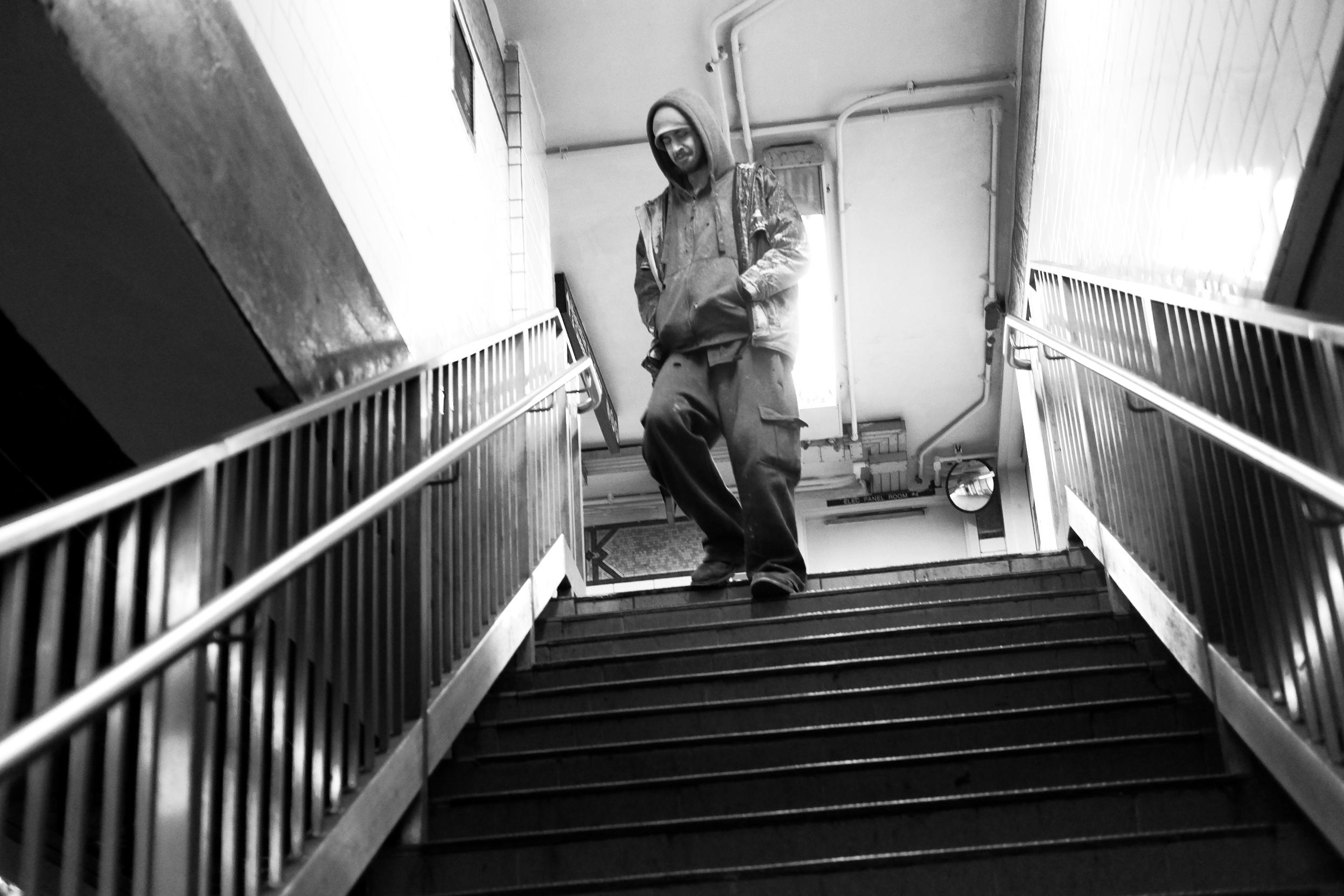 Man Walking Down Stairs.jpg