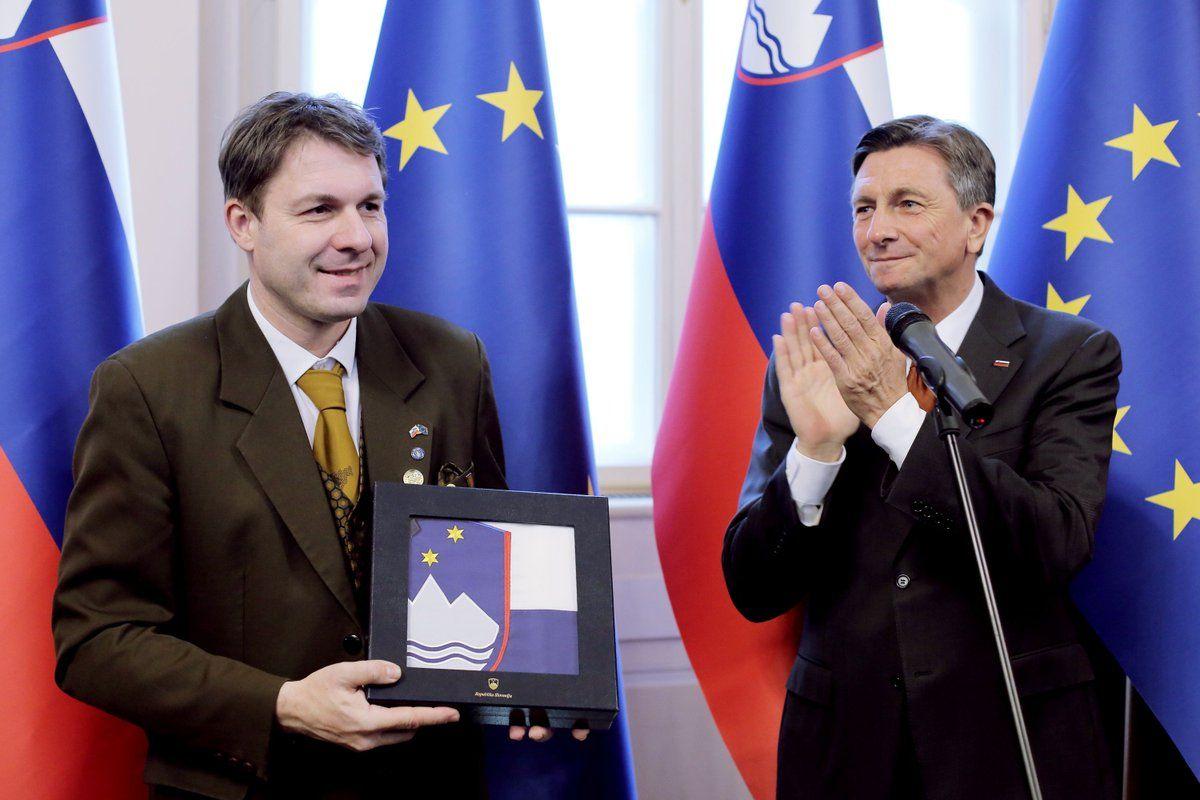 Boštjan Noč is presented an award by Dejan Židan,Deputy Prime Minister of the Republic of Slovenia