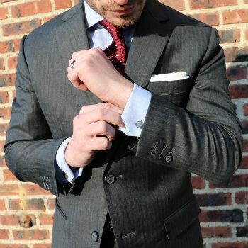 Man-adjusting-sleeve-of-power-suit.jpg