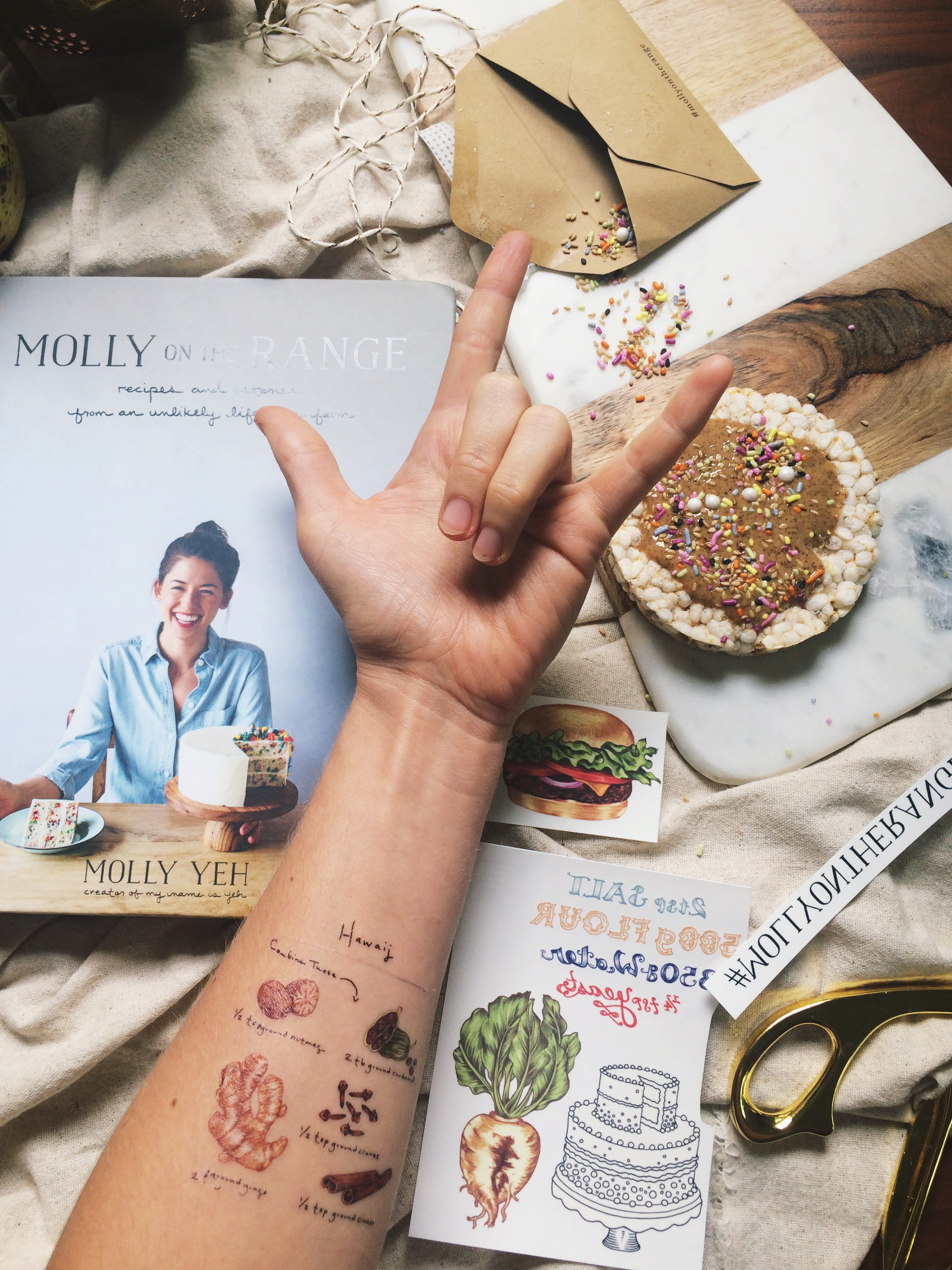 Yes that's a hawaij temporary tattoo on my arm. And a rice cake with almond butter and Molly's sesame cardamom sprinkles!