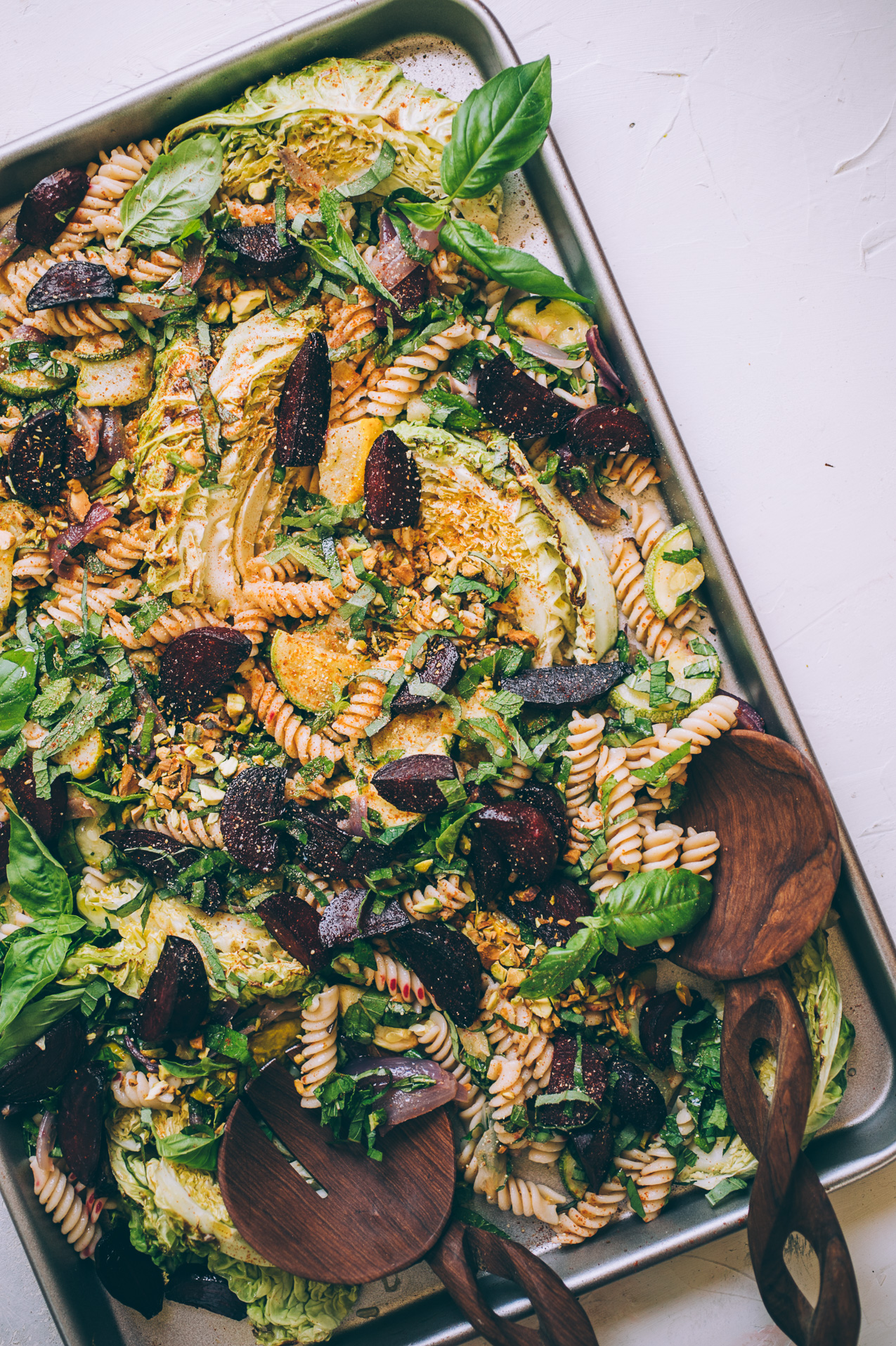 roasted farmers market pasta salad with basil, mint and pistachios