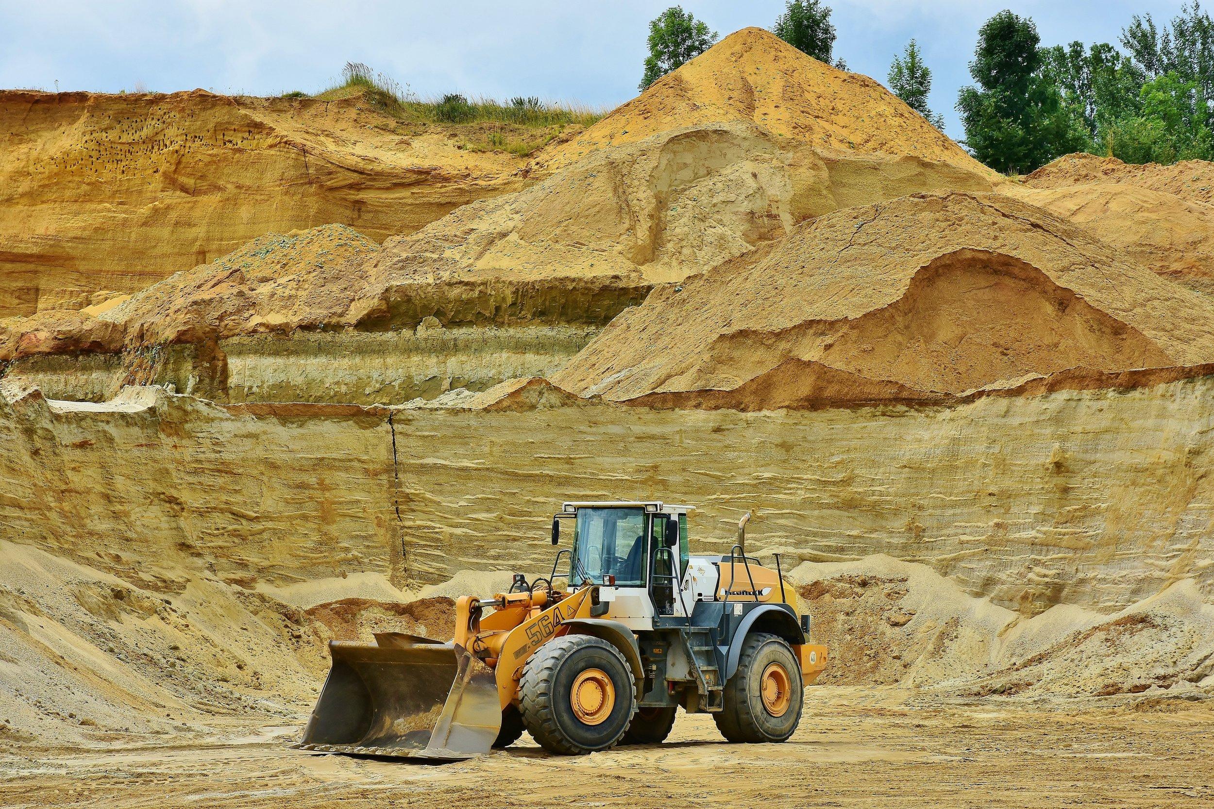 backhoe-bucket-barren-dirt-461789.jpg