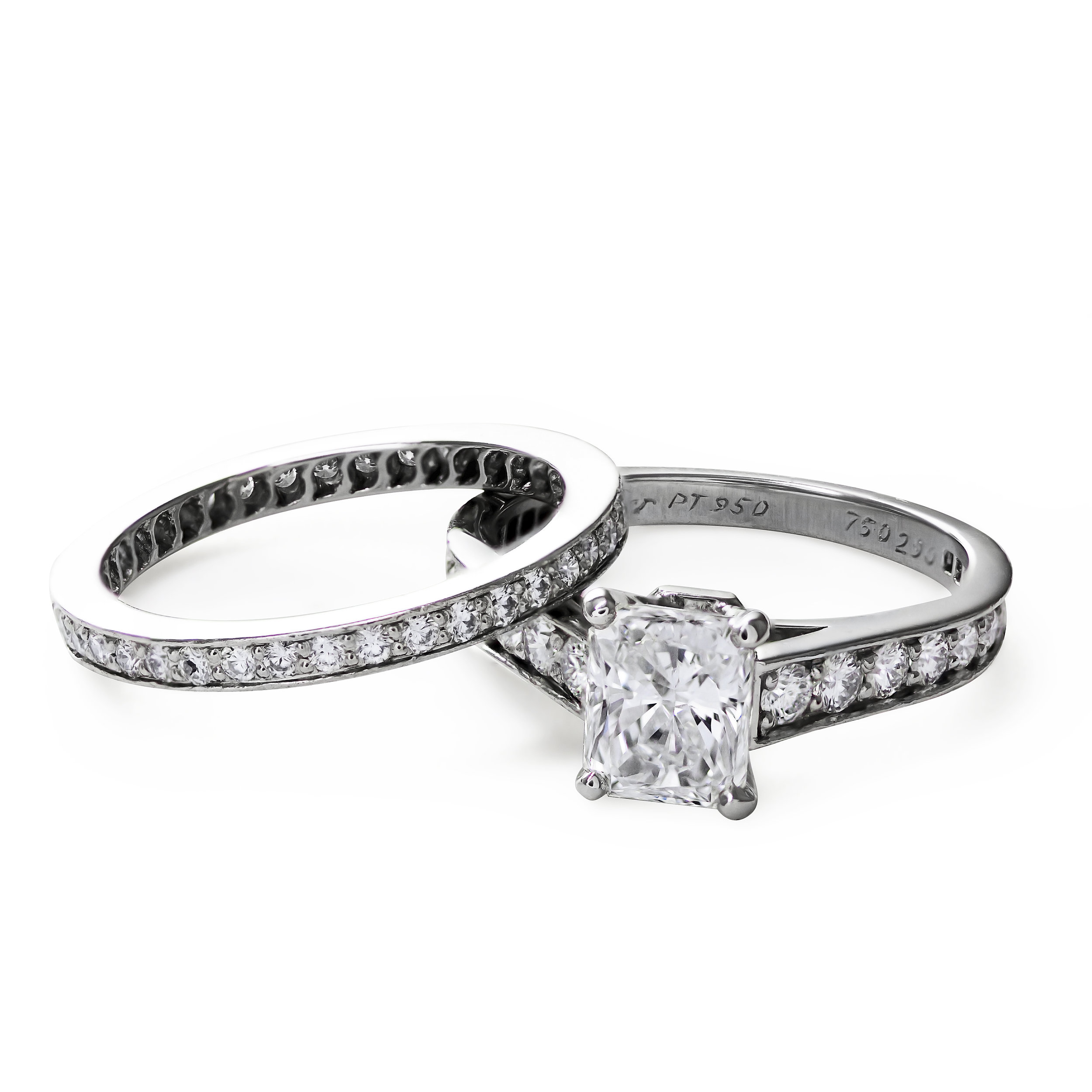 Cartier 1895 Radiant Cut Engagement Ring with a matching channel prong set diamond wedding band