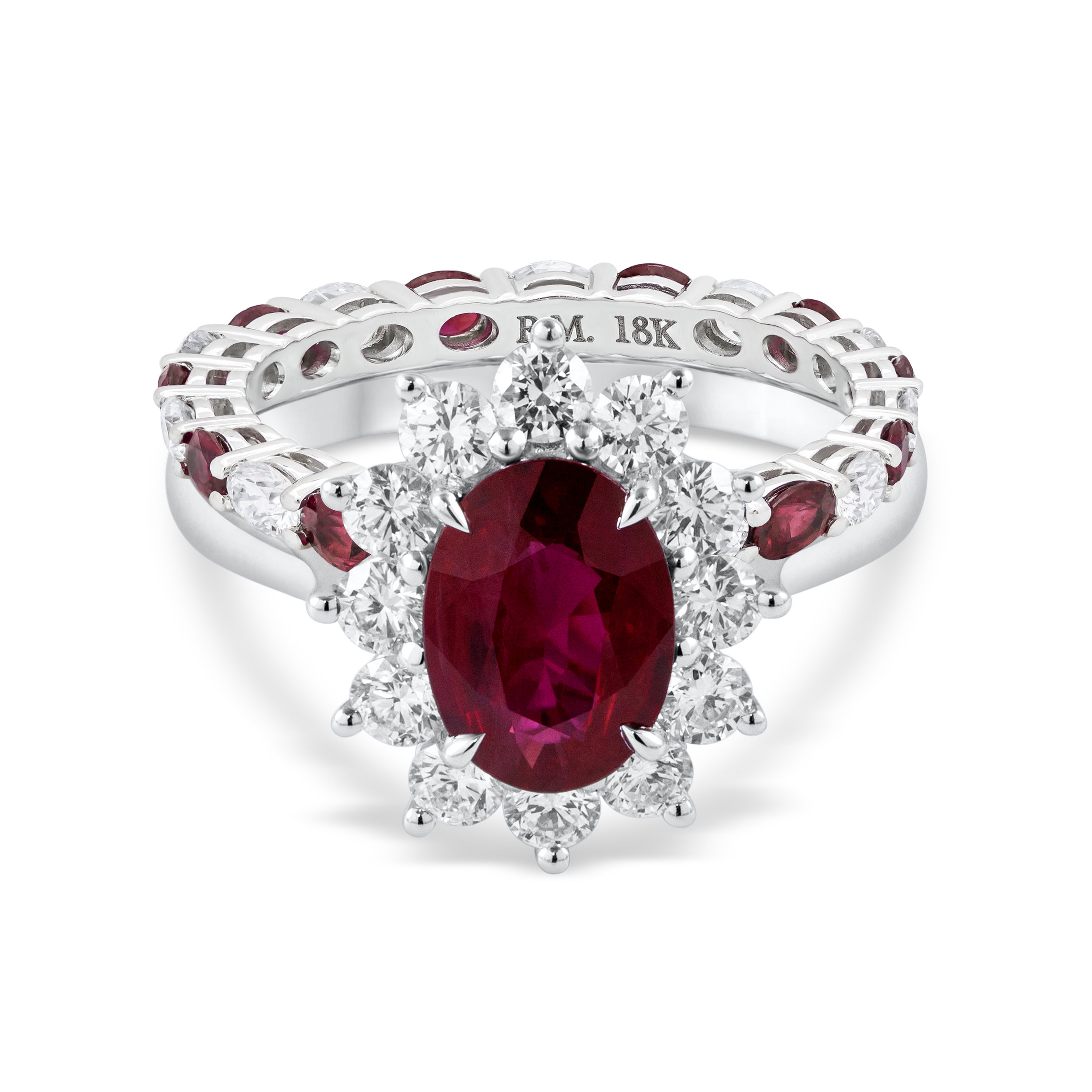 Vibrant oval cut ruby engagement ring with a diamond halo matched with an  alternating ruby and diamond eternity wedding band.