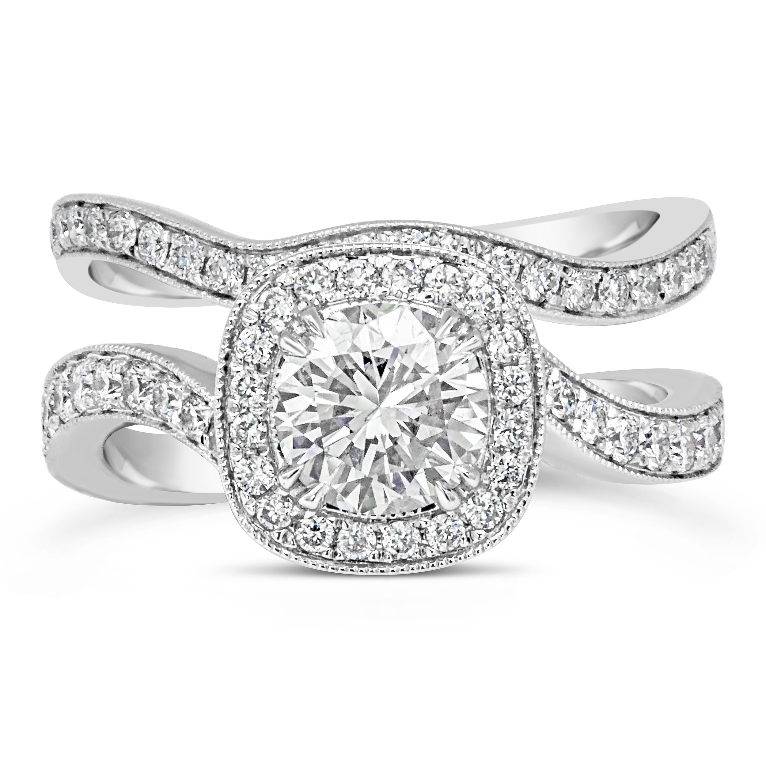 A custom-designed bypass halo engagement ring with a matching curved diamond wedding band.