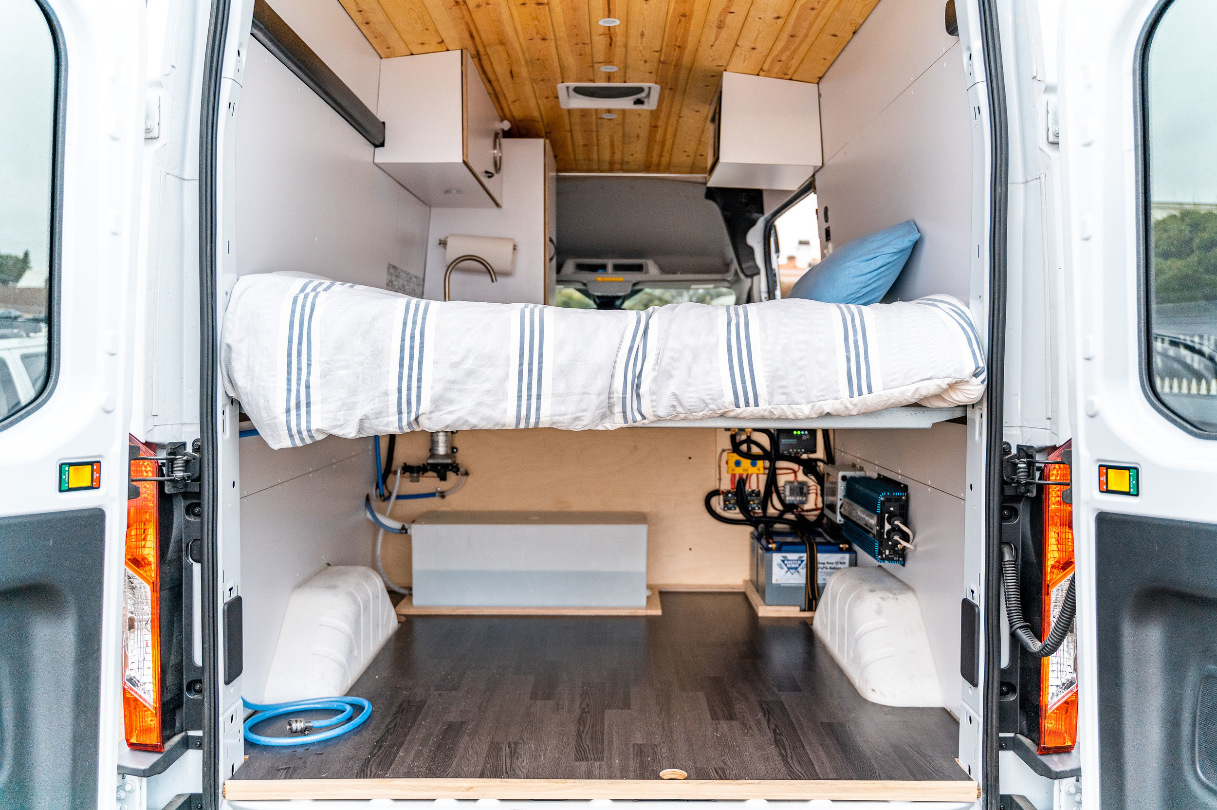 Does your van life include hauling gear or mountain bikes? Tour our platform bed layout.