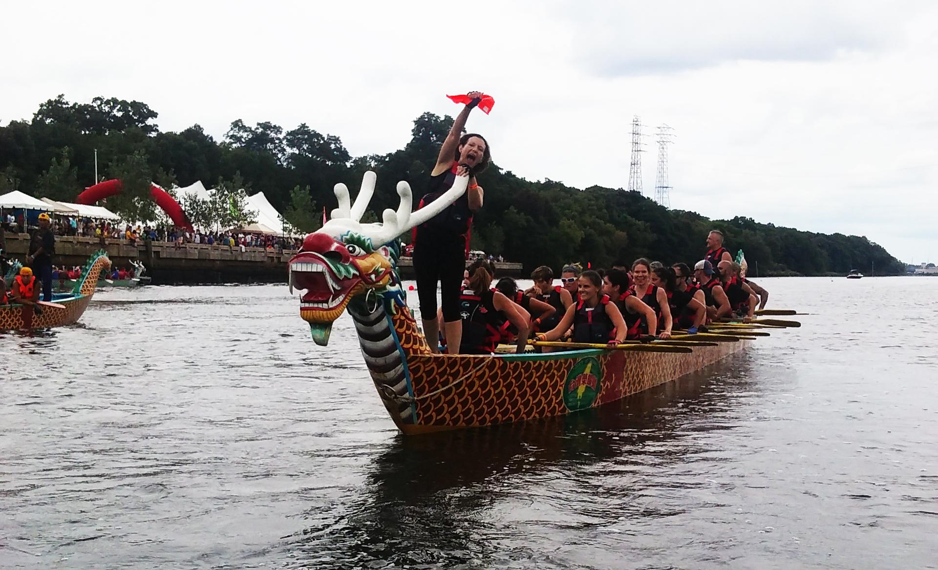 James Toomey - RI Dragon Boat Fest_winner with flag.jpg