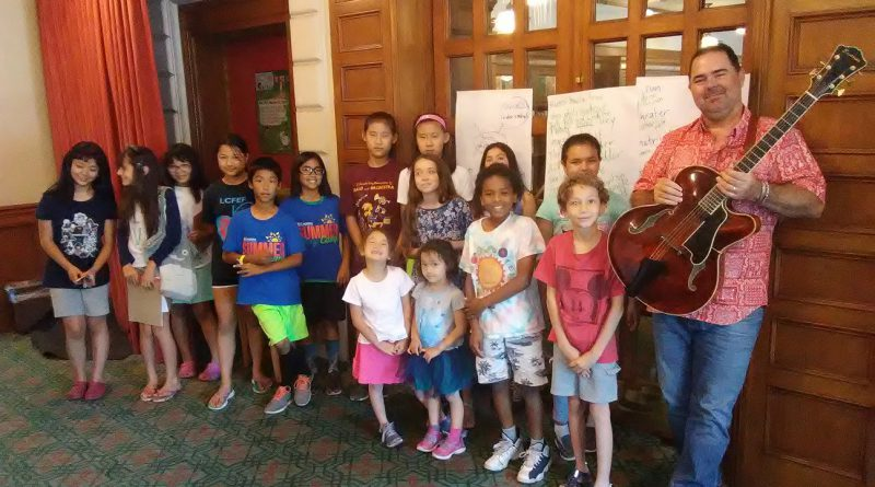 Tim Griffin with his songwriting class at the Pasadena Public Library (Photo: AnnMarie Hurtado). Full story here -