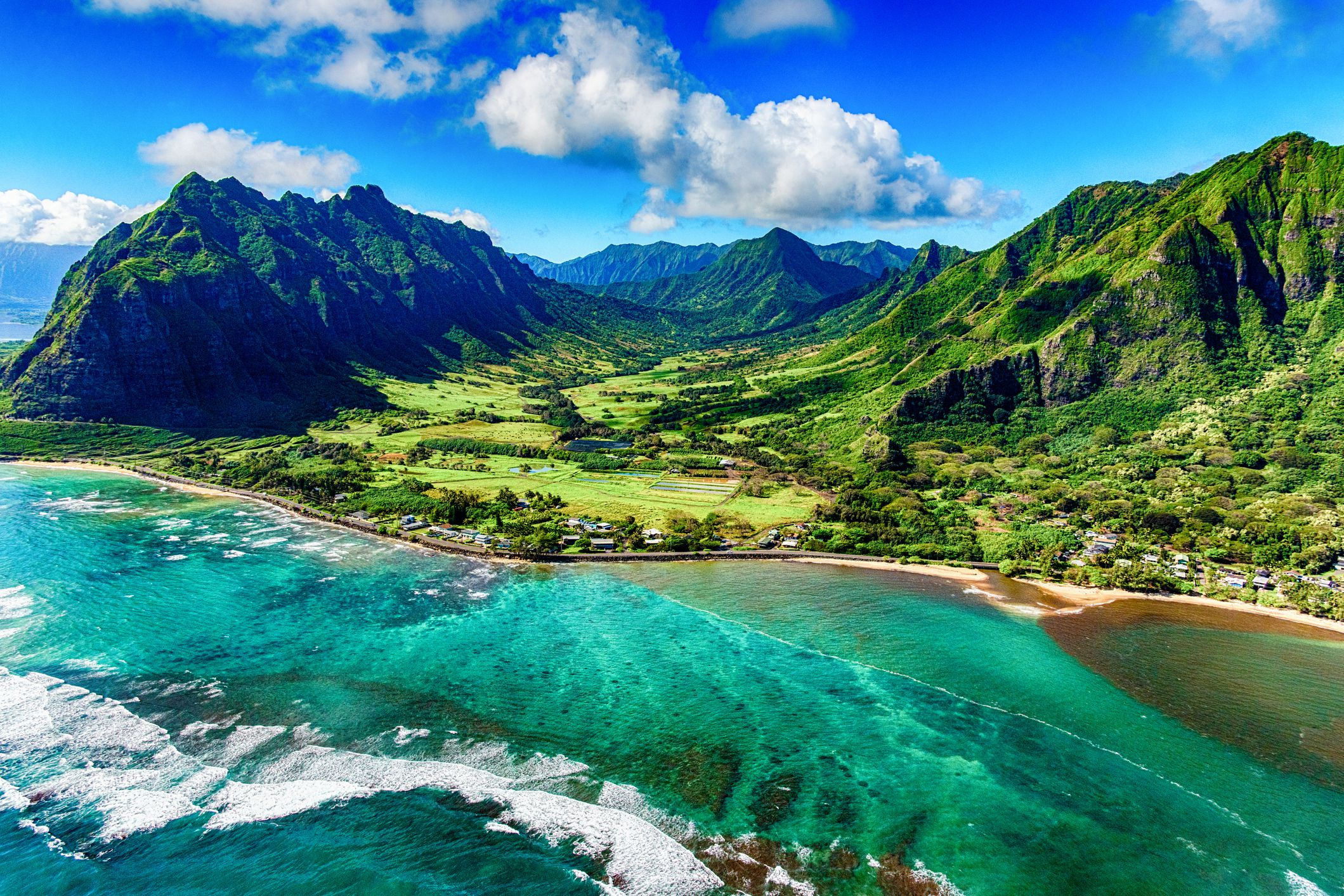 aerial-view-of-kualoa-area-of-oahu-hawaii-938335974-5c0ac2b846e0fb0001aa630e.jpg
