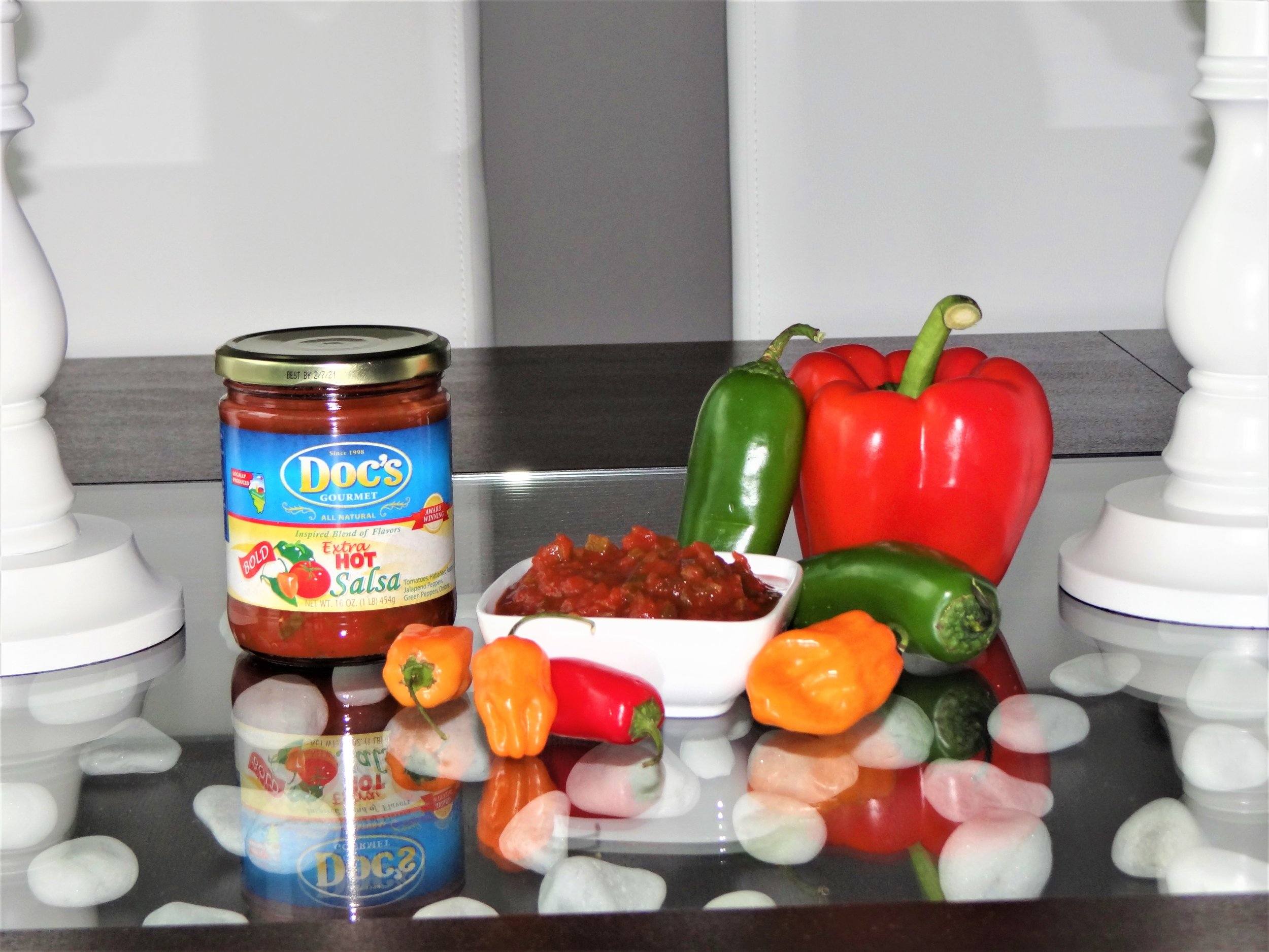 """Doc's Extra Hot Salsa - Consider it the """"hottest"""" sibling in the bunch.With the addition of habanero peppers to the already spicy blend of tomatoes and pepper, this salsa hits your pallet in all the right spots and makes you come back for more.Tip: Use in your favorite chili; and for a totally veggie chili, pair Extra Hot with our Spicy Black Bean Salsa!"""