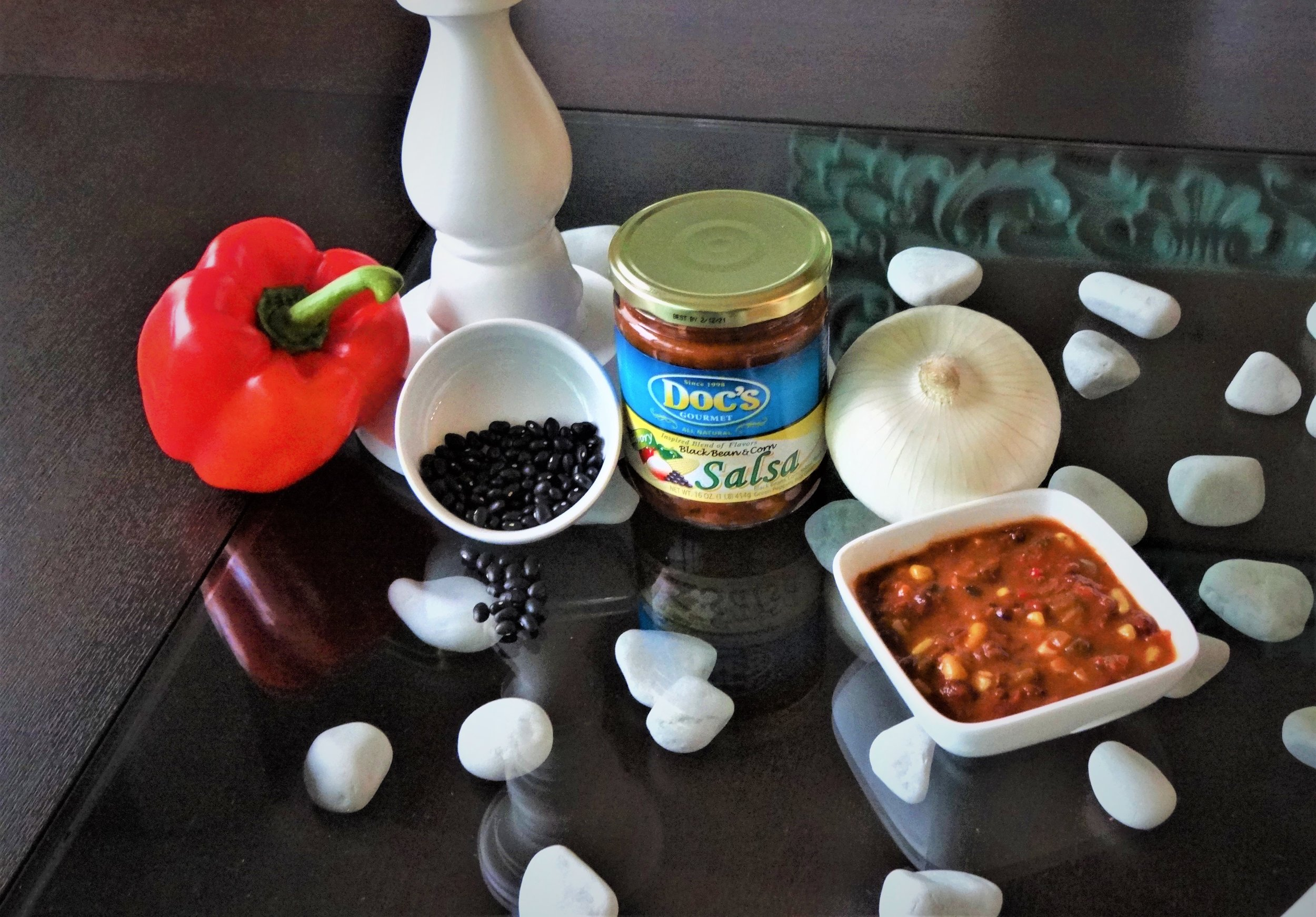 Doc's Black Bean & Corn Salsa - A mild savory blend of tomatoes, and peppers, with the fresh taste of corn and black beans that you can actually see and appreciate.This special salsa is mild enough that everyone can enjoy it, (even your little ones) and it can be used to add just enough kick to any dish.