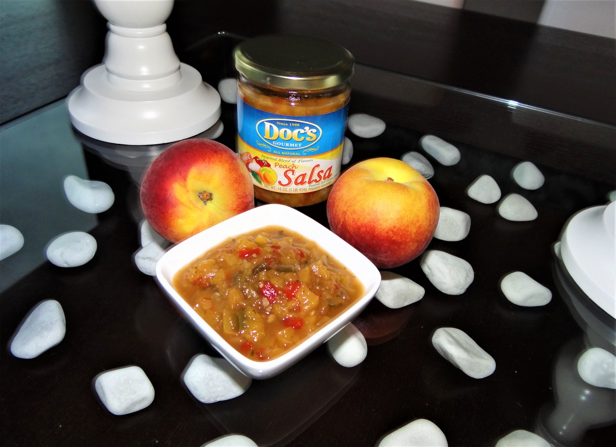 Doc's Peach Salsa - This sweet and spicy blend of peaches and peppers is great to make your favorite dip with, or to top the wildest fish.Use this gourmet specialty salsa when baking your contest winning bread recipes, and it's especially tasty in any cornbread recipe.If you want to impress your family and friends at any gathering, just add Doc's Peach Salsa.Tip: For any quick fish, chicken, or pork (including ham for the holidays), simply add Doc's Peach Salsa for the perfect glaze.