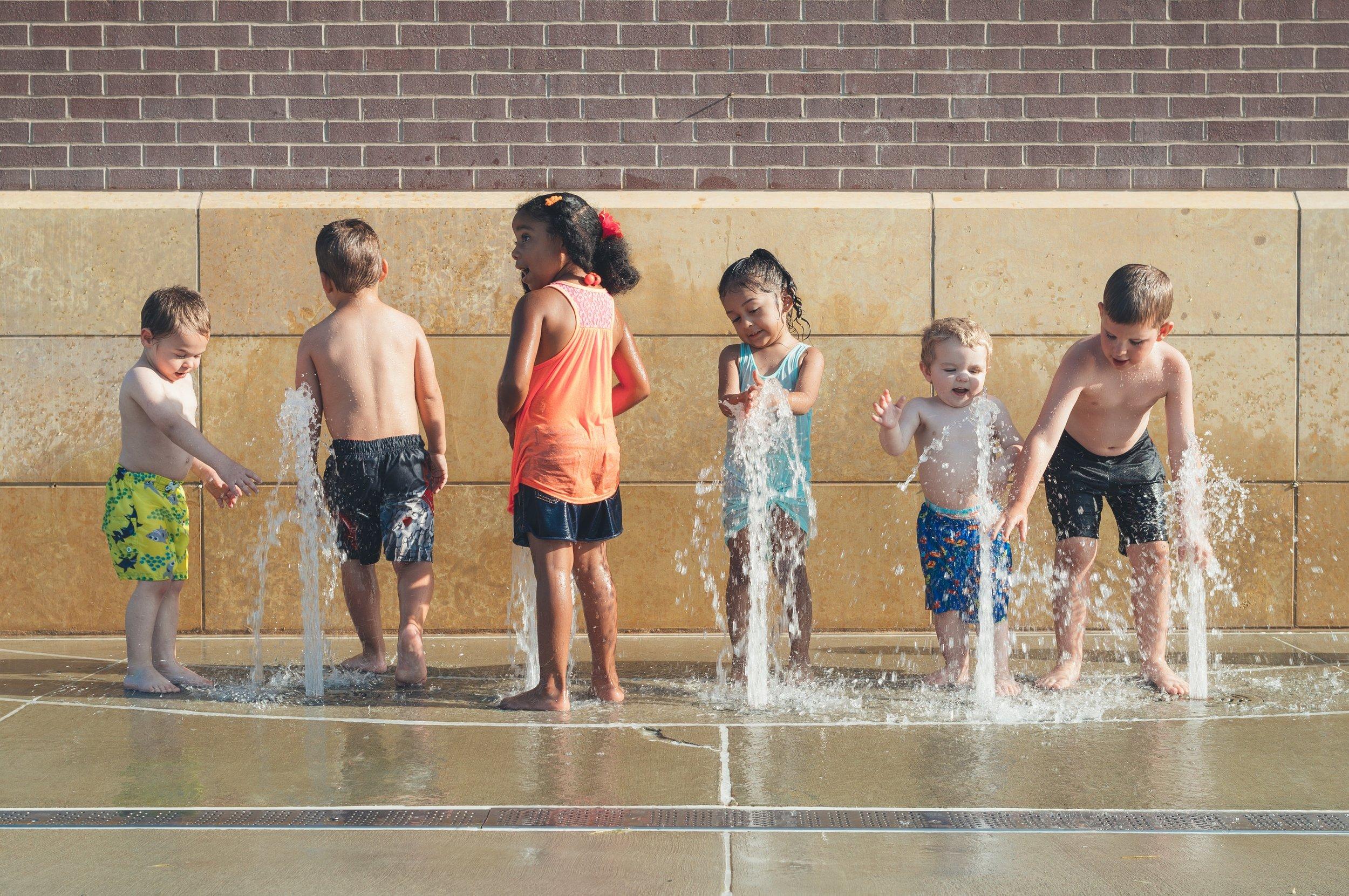 02_children_in_community_photo-1521220609214-a8552380c7a4.jpg