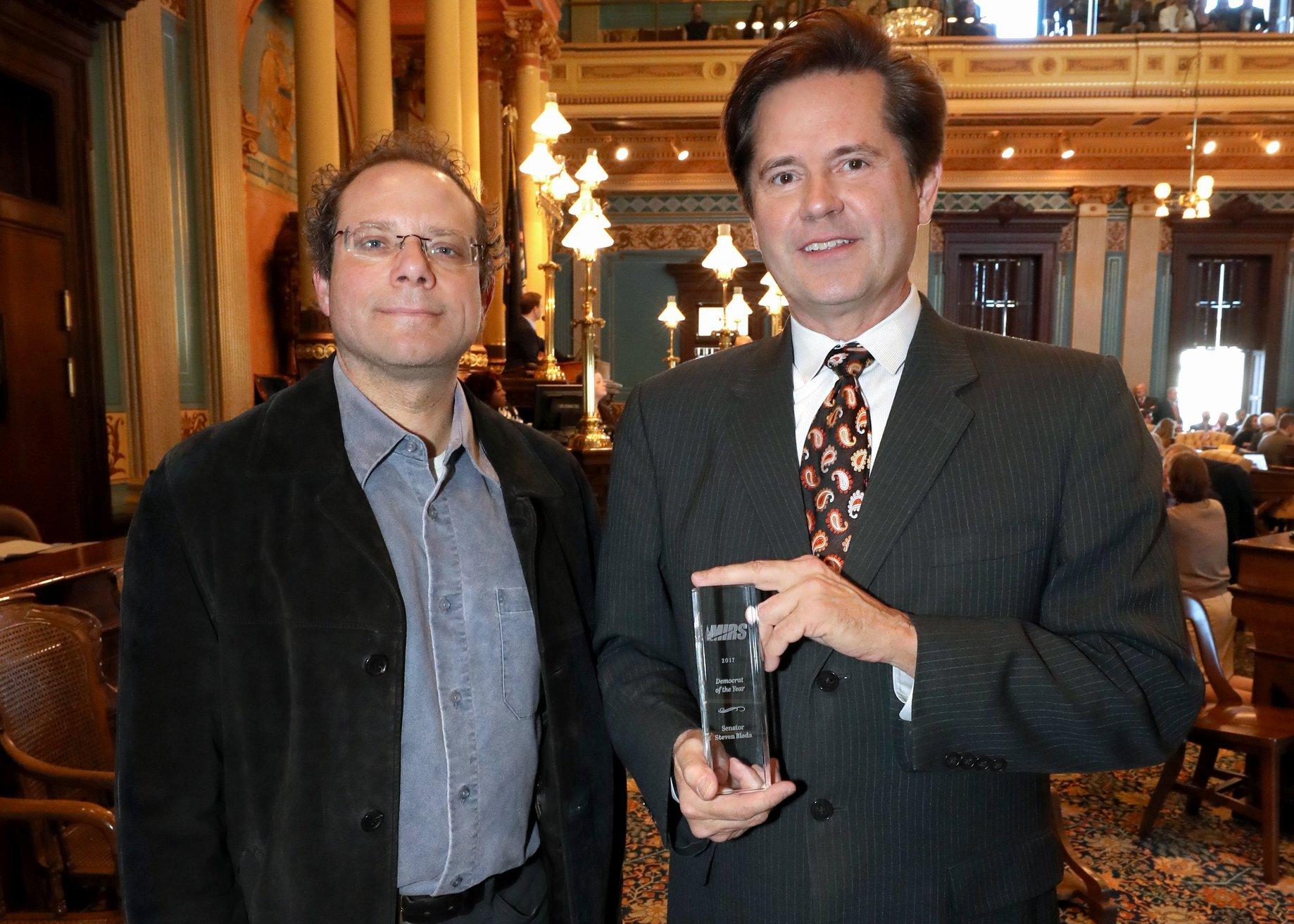 "State Sen. Steve Bieda (D-Warren) accepting the MIRS 2017 ""Michigan Democrat of the Year"" award from Editor Kyle Melinn."