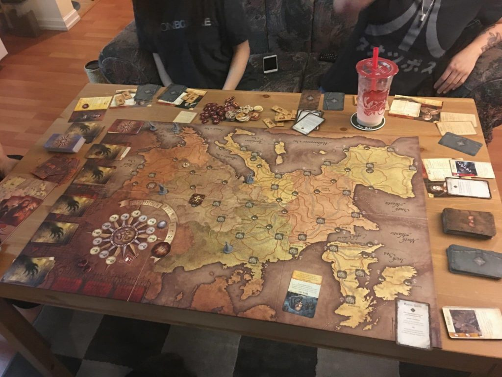 Andrew and friends playing the  Fury of Dracula board game. Photo courtesy of Andrew Poirier