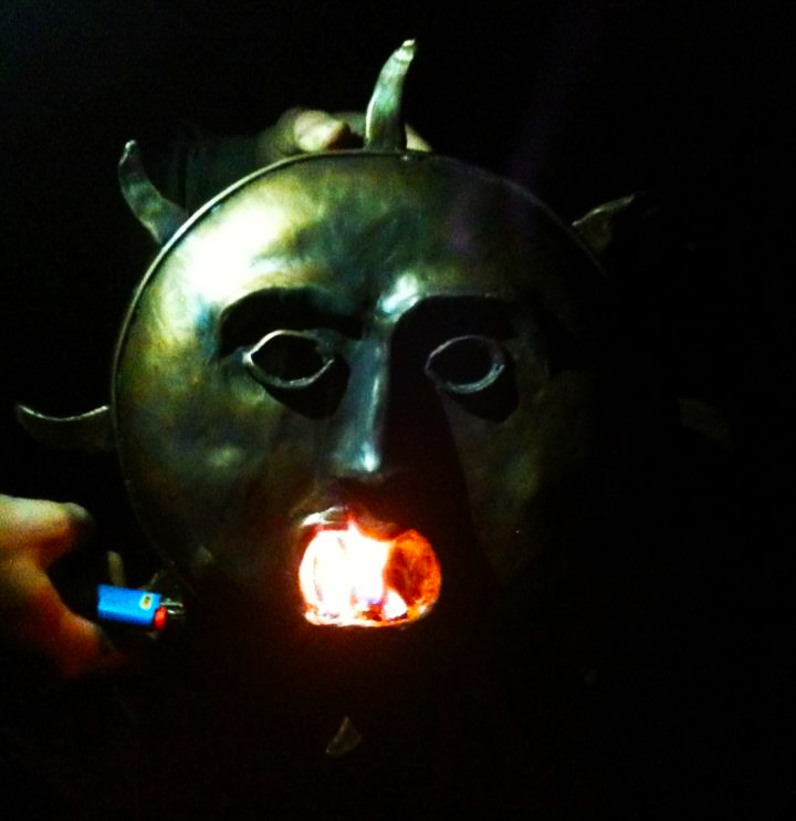 Bronze Sun Mask. An oil reservoir is contained inside of the chin, and wicks are inserted into the mouth and set on fire. Then you can mount it onto a pole and take it to festivals and parades and such. I was going for a somewhat crude, Lovecraftian vibe, and I think I succeeded.