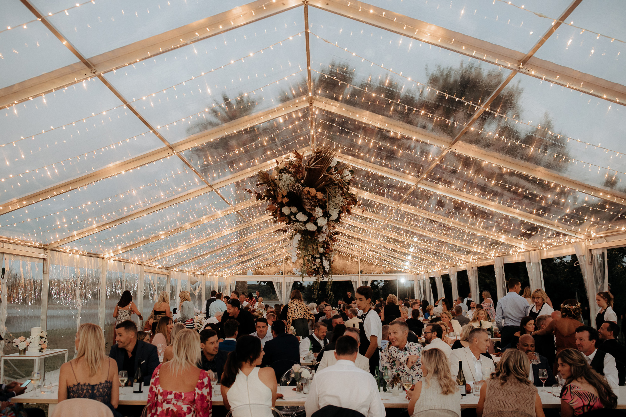 Marquee wedding, fairy lights and chandelier