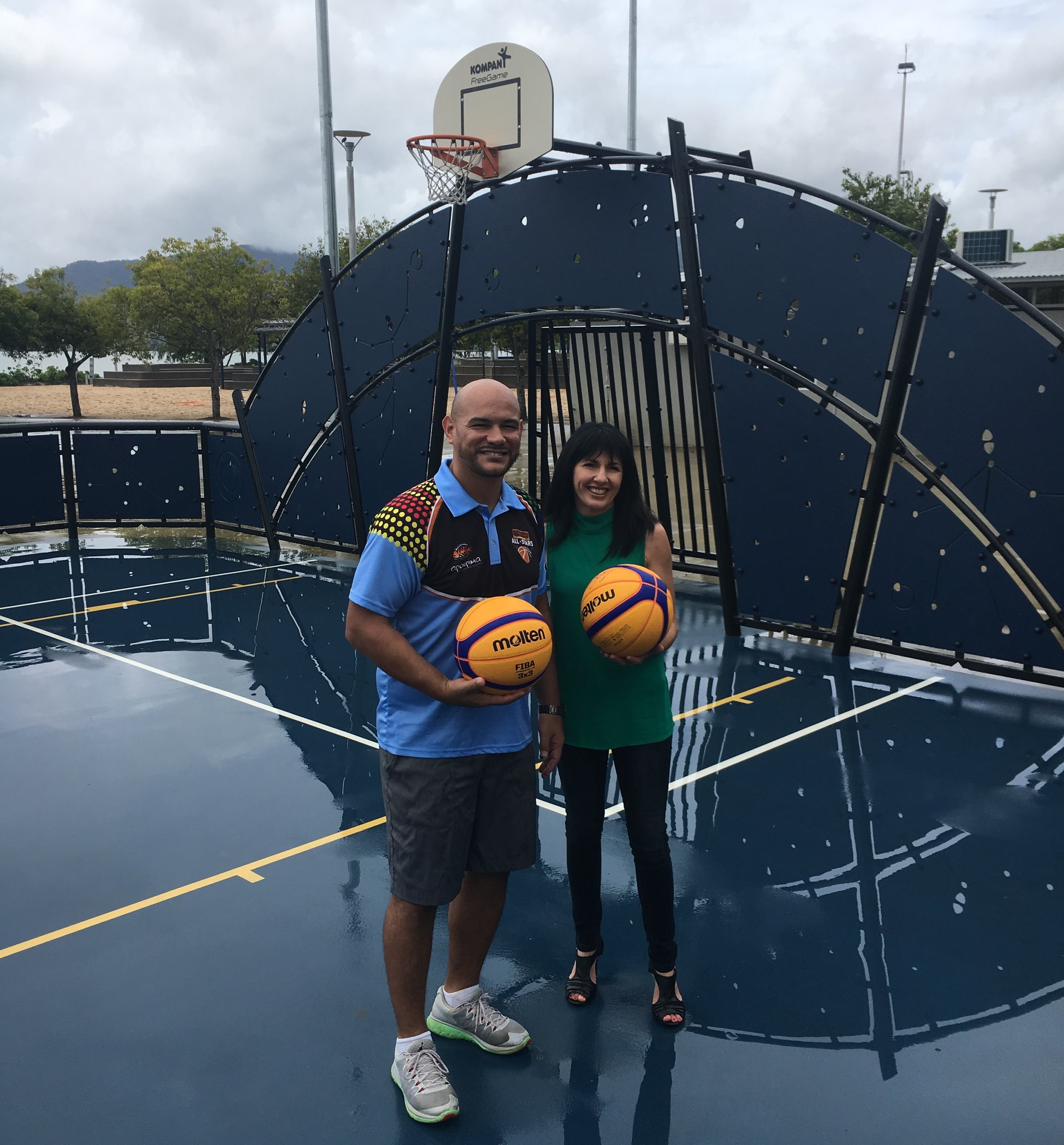 Australian Indigenous All Stars Head Coach Joel Khalu joins with Cr. Cathy Zeiger from the Cairns Regional Council at today's Cairns 3X3 Reconciliation Basketball Tournament launch at the Cairns Esplanade Basketball Court.Picture: Provided.