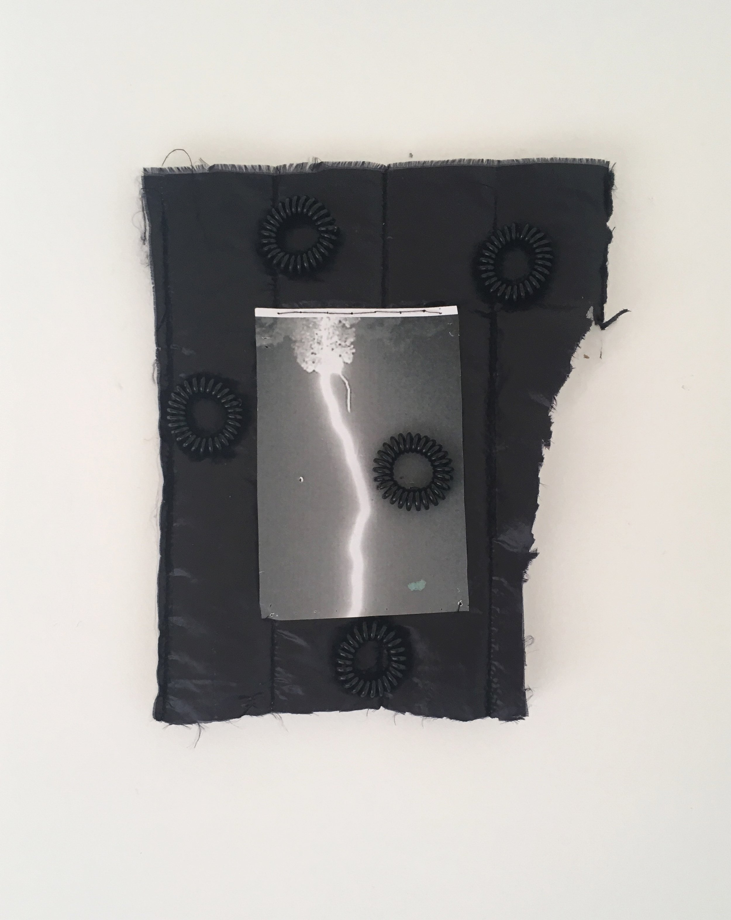 Untitled,  2019, paper fabric fragment with coils
