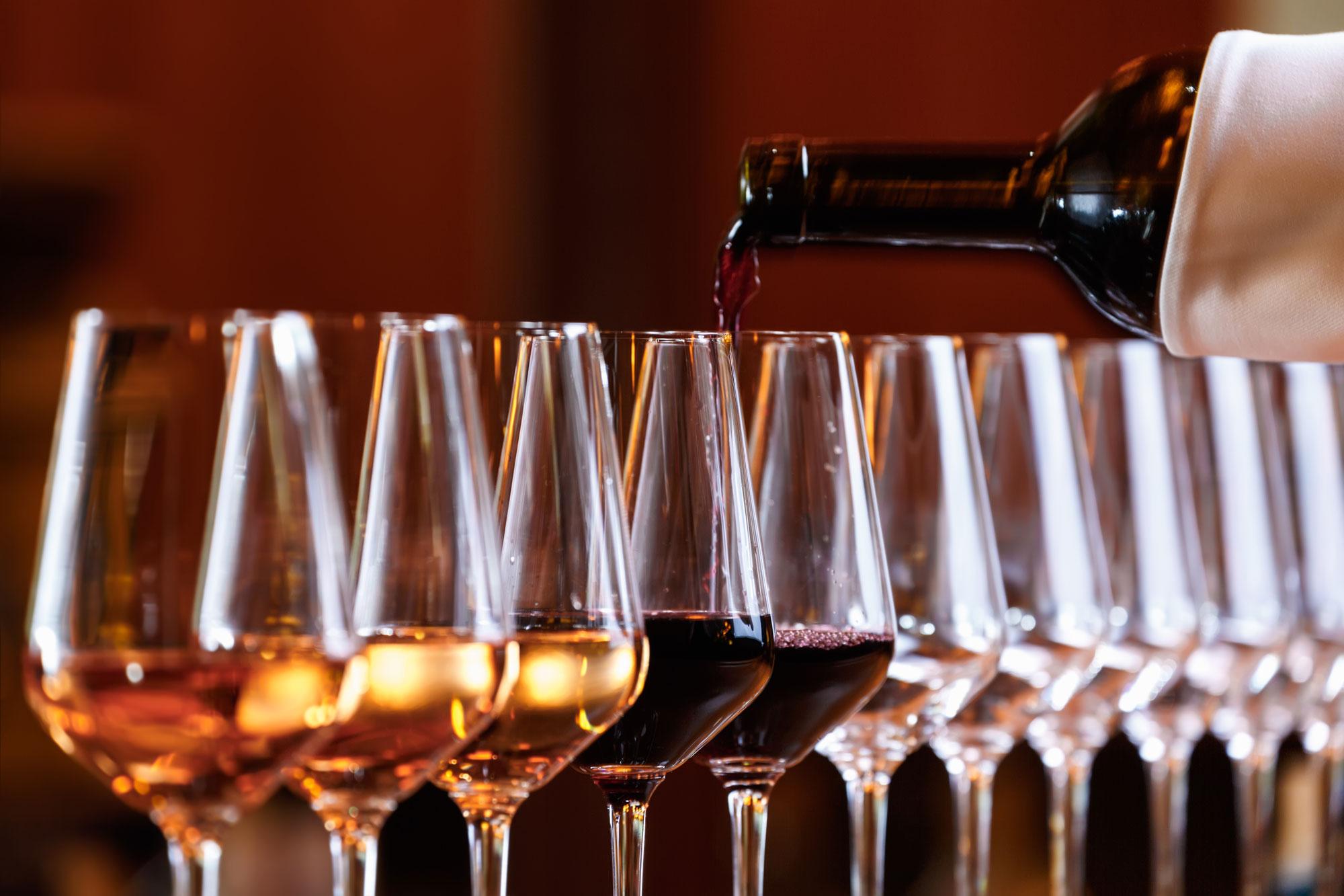 bigstock-Wine-Glasses-In-A-Row-Pouring-275011180web.jpg