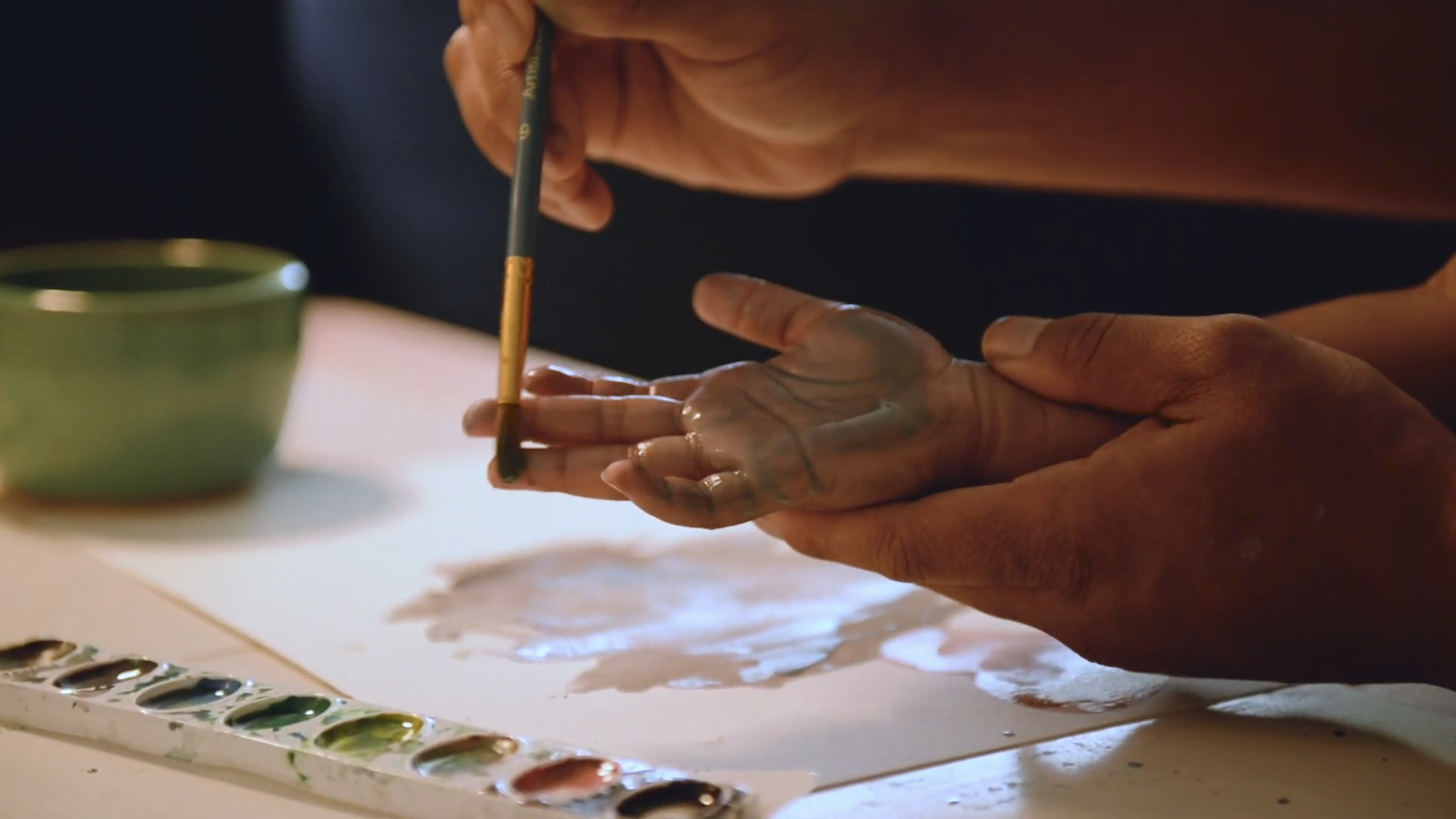 Jennifer creating art with her daughter Essence
