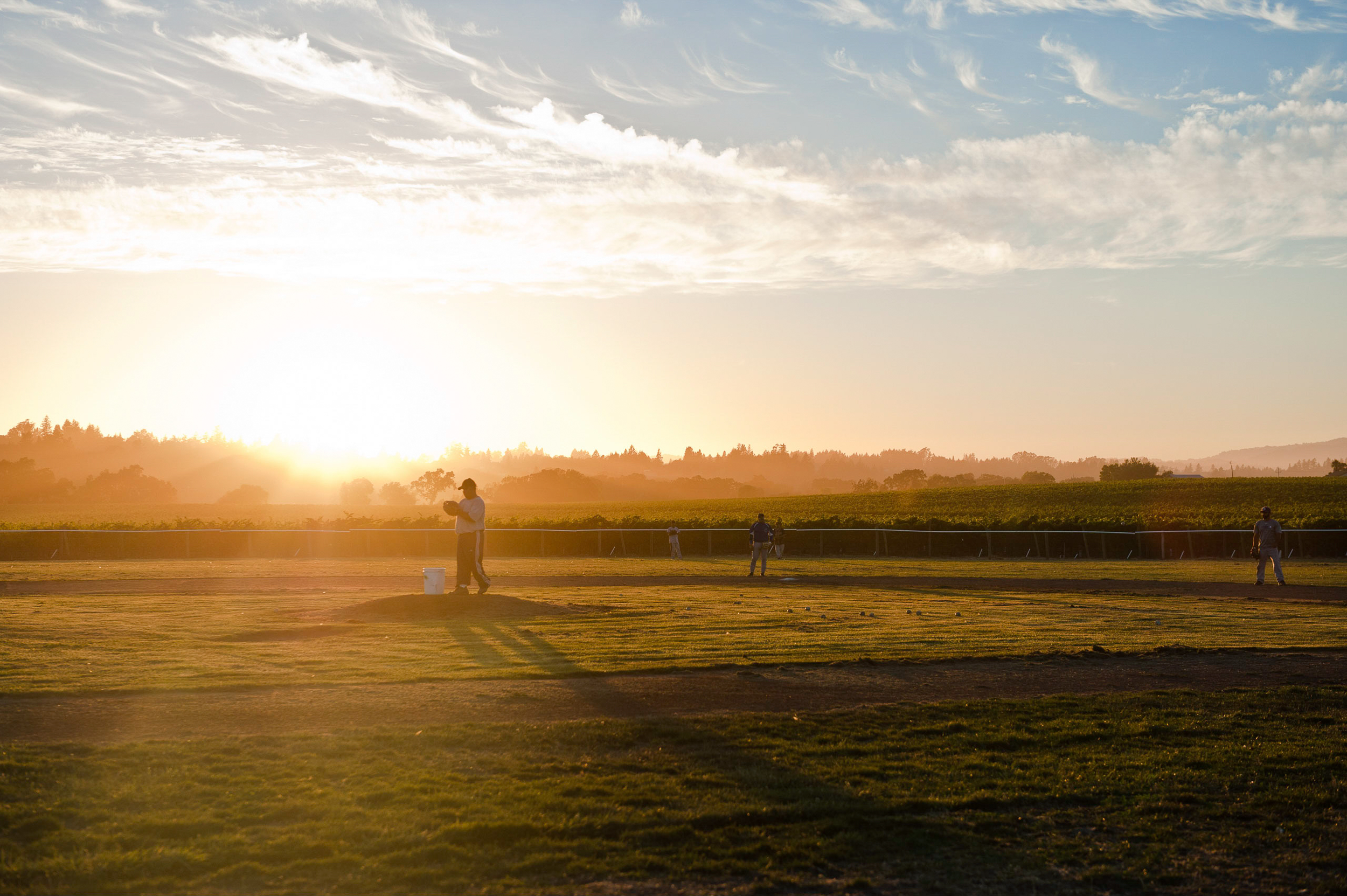 Sunset_image_of_people_playing_on_the_field_of_dreams.png