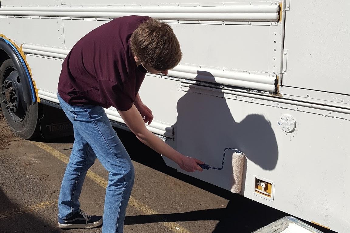 me painting bus yea.jpg