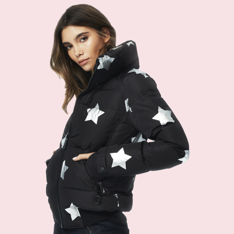 SAM. - STAR FREESTYLE BOMBER - This star-spangled, down-filled fall and winter wardrobe essential is the perfect piece. Jersey cuffs, thumbholes, and a little bit of pizzazz.