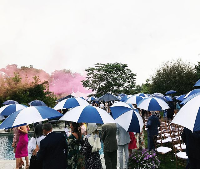 Rain, rain... even if you don't go away, a wedding can still be spectacular, possibly even more romantic (especially with pink smoke bombs to lead the way to dinner)! 💗🔮 . . . . #ashleyabbottevents #events #eventplanner #eventdesign #eventstyling #eventdecor #garden #backyard #backyardwedding #wedding #weddingdecor #hamptons #hamptonswedding #summer #weddingideas #cocktails #wainscott #weddingplanner #rainwedding #romantic #pinksmoke #secretgarden #makingthebestofit #umbrella #rain