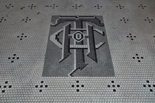 hand-trading-company-mosaic-tile-entrance-photograph-copyright-brian-brown-vanishing-south-georgia-usa-2009.jpg
