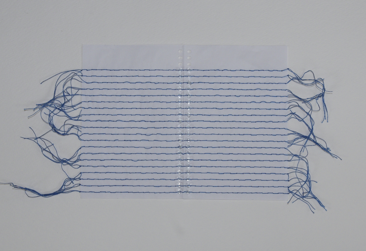 Recto Verso II , 2014, embroidery thread,beads, and mini notebook paper