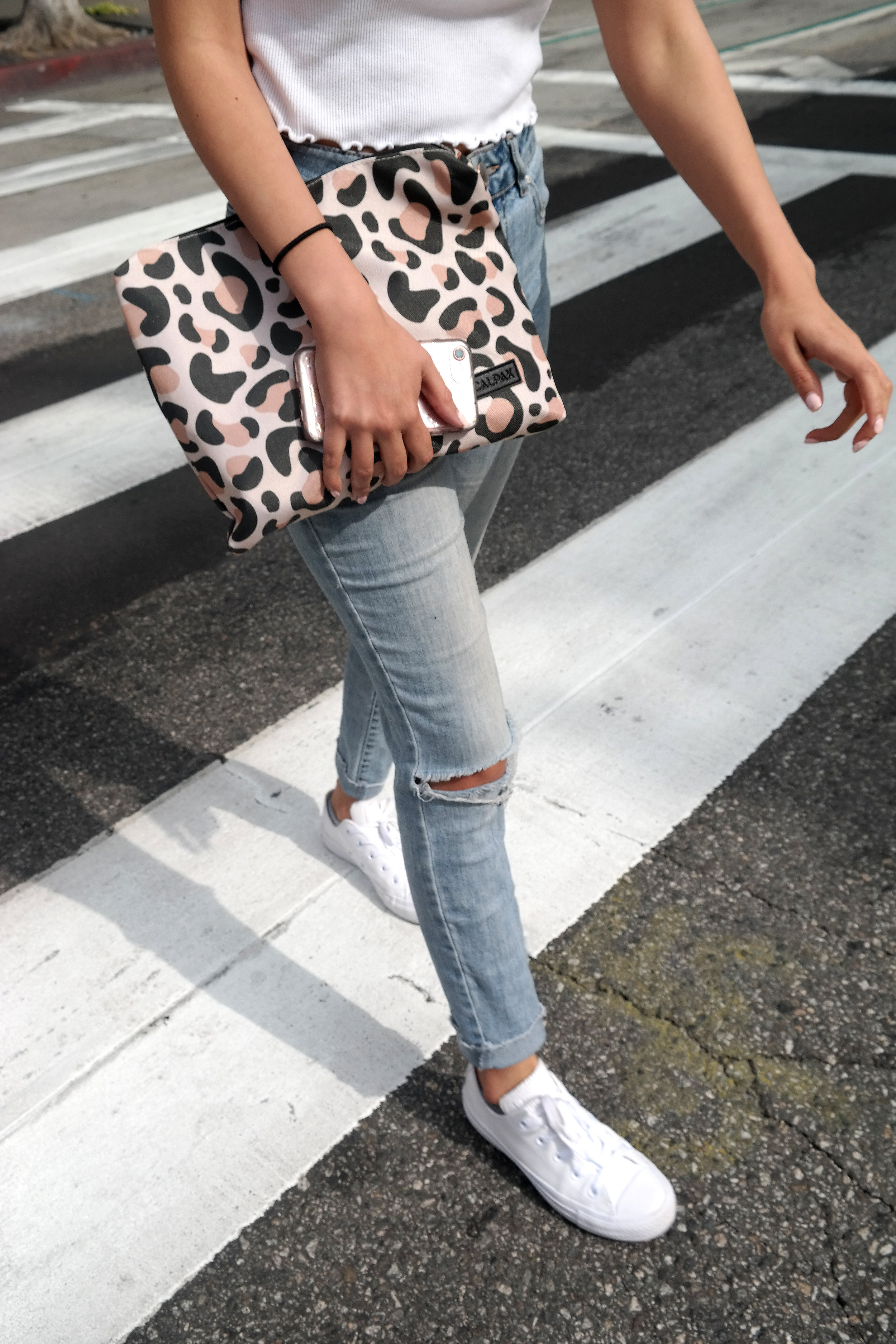 CALPAK's leopard print pouch from packing cubes on the go.