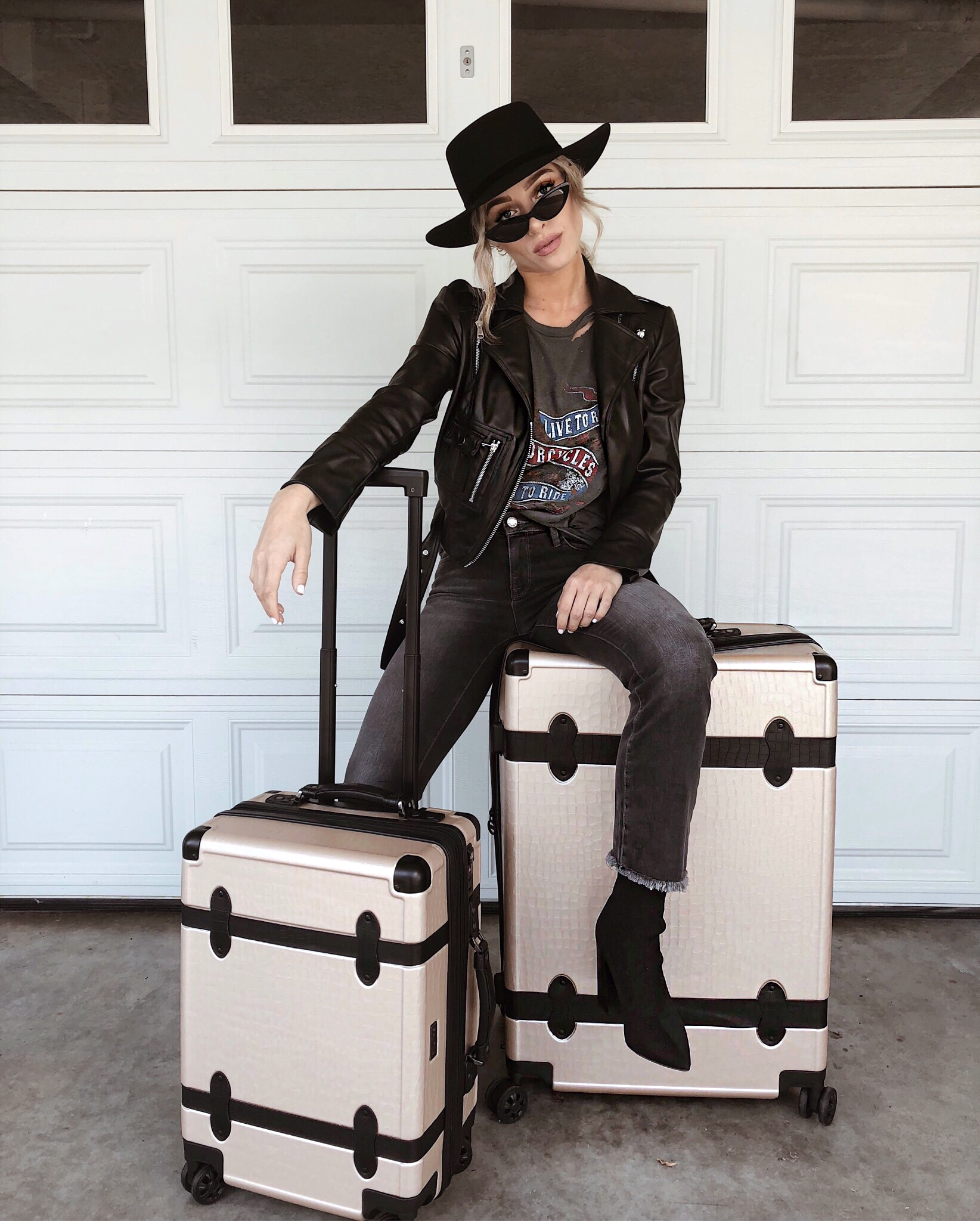 @thestyleseed sitting on CALPAK's Large Trnk luggage in nude, along with CALPAK's carry-on Trnk luggage.