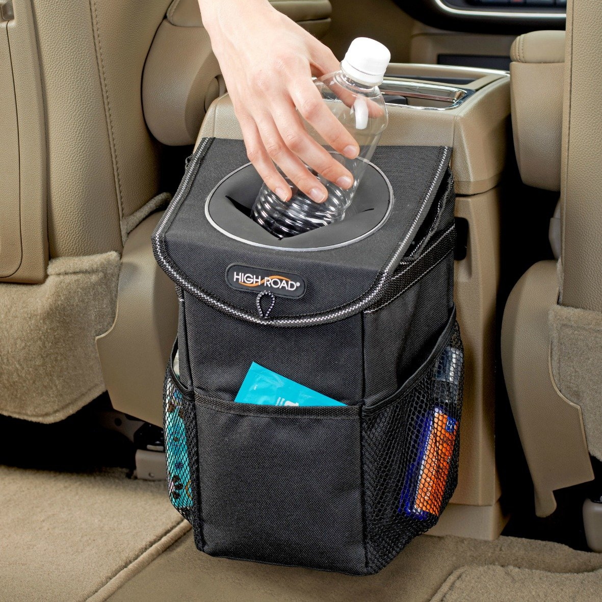 Car Trash Can - Don't be that person who stuffs their trash in the side pockets of the car door or worse, on the floor of the vehicle. This covered storage is leakproof, helps with odor control, and attaches to the back of your center console. It's compact and even has outside pockets for other small items you rather not be floating around.