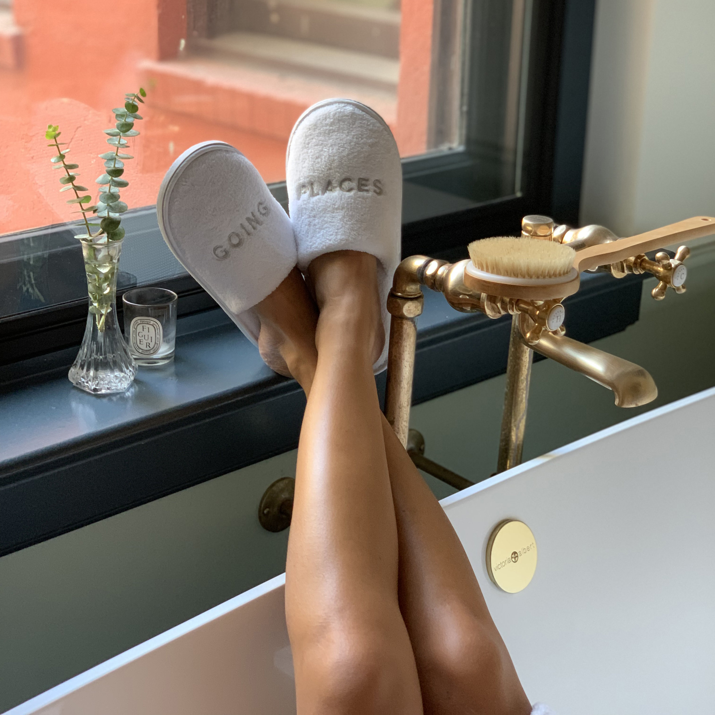 Going Places Slippers - You don't have to go out to go places—it's a state of mind. Whether you're relaxing at home or kicking back in your hotel room after a day spent exploring, these plush slippers bring the comfort.