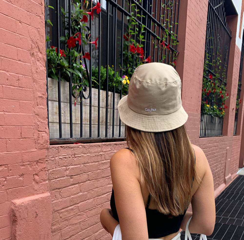 Everywhere Bucket Hat - Whether you're running errands, headed to the beach, or doing some sightseeing—don't leave home without this bucket hat. Made from canvas and embroidered with the CALPAK logo, it's your out-and-about go-to for staying protected from the sun, and looking good while you're at it.