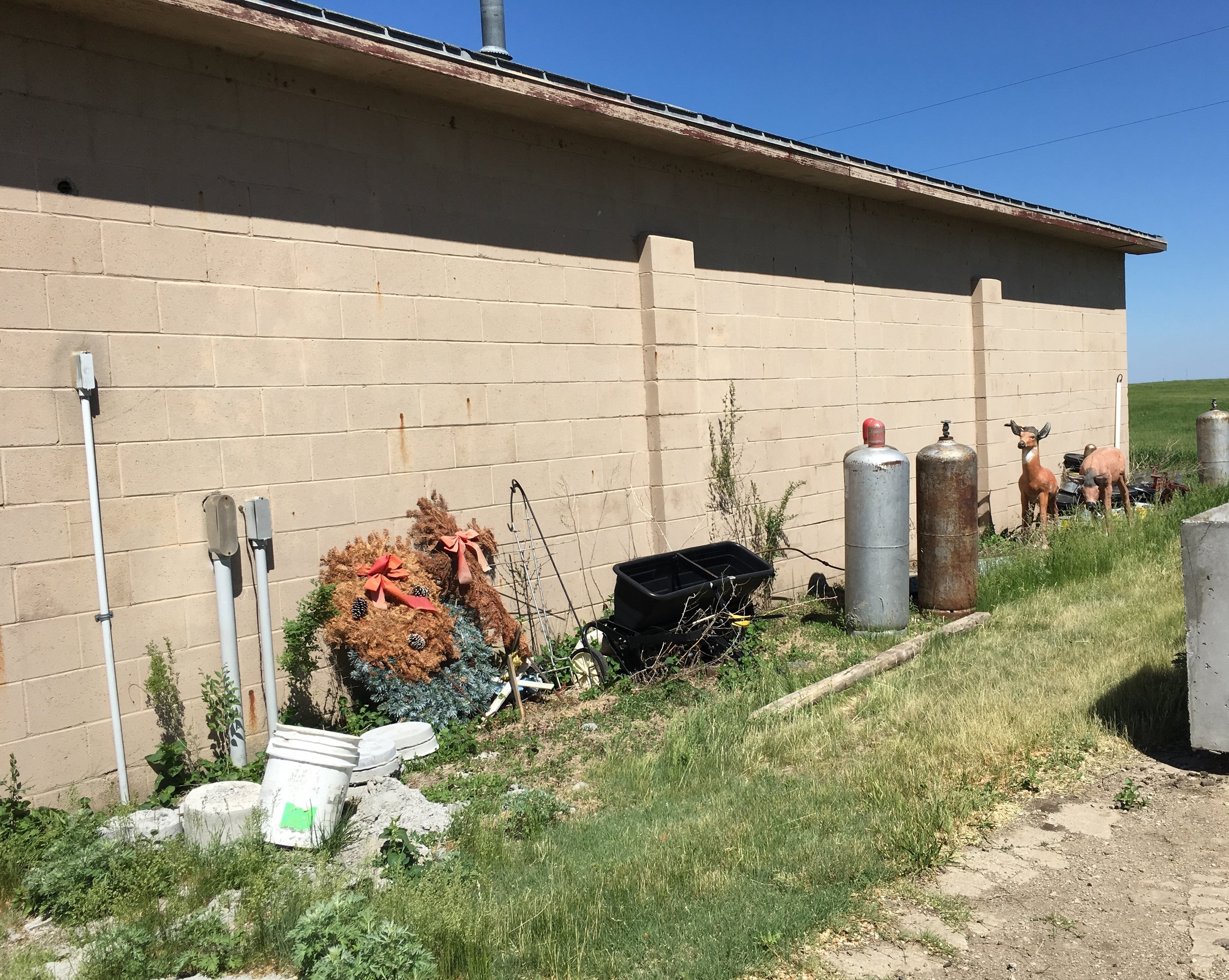 Restlawn utility building trash.JPG